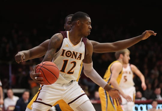Iona forward Tajuan Agee (12) works against Quinnipiac forward Abdulai Bundu (34) during mens basketball game at the Hynes Athletic Center on the campus of  Iona College in New Rochelle on Friday, February 8, 2019.