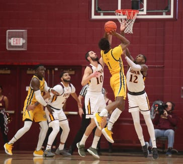 Iona forwards Andrija Ristanovic (10) and   Tajuan Agee (12) douyble team Quinnipiac guard Cameron Young (1) during mens basketball game at the Hynes Athletic Center on the campus of  Iona College in New Rochelle on Friday, February 8, 2019.