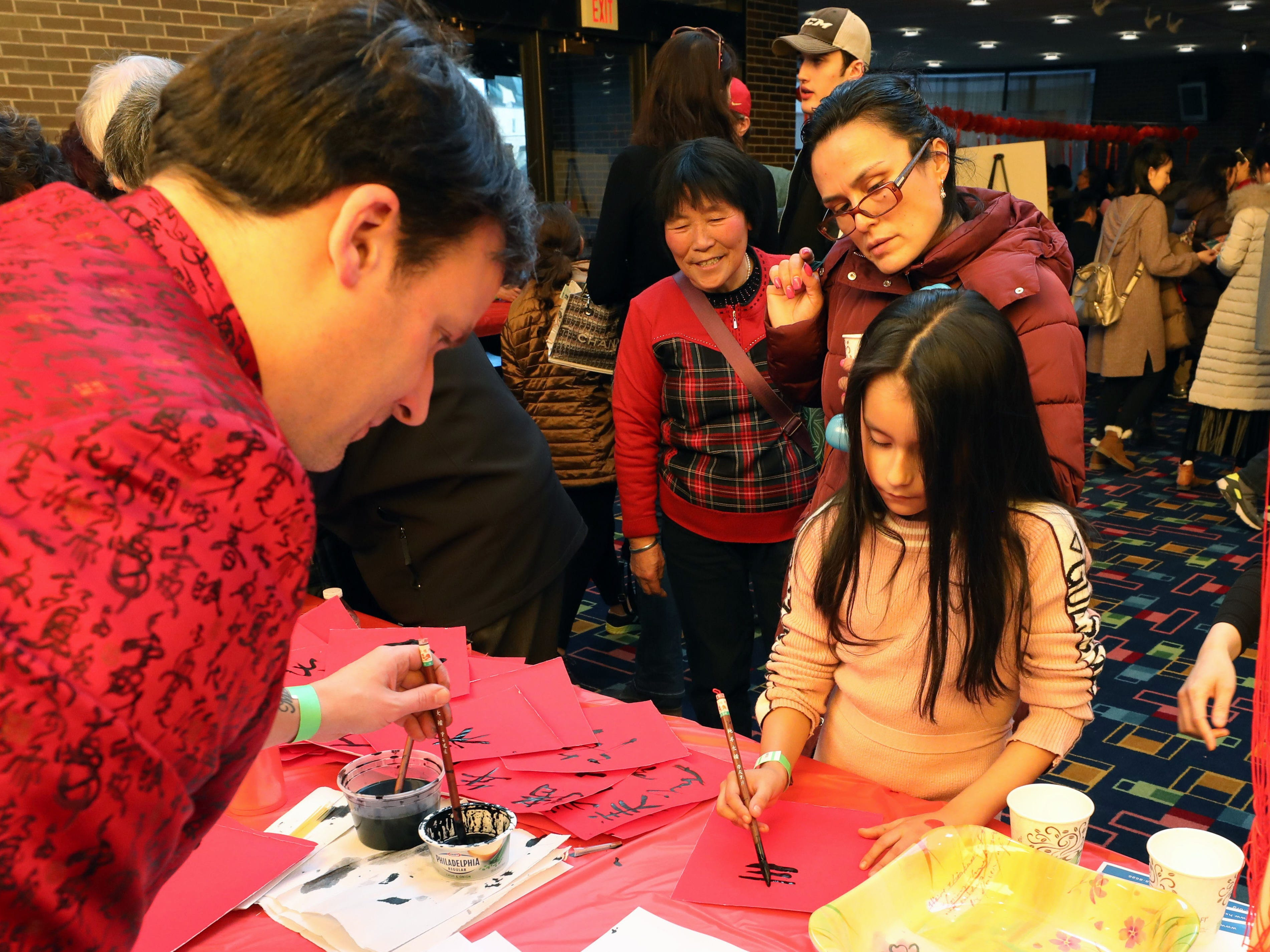 Isabella Creollo, 7, tries her hand at copying a Chinese character, during the 30th Chinese New Year Festival, the Year of the Pig, sponsored by WACA (Westchester Association of Chinese Americans), at The Performing Arts Center at Purchase College SUNY, Feb. 9, 2019.