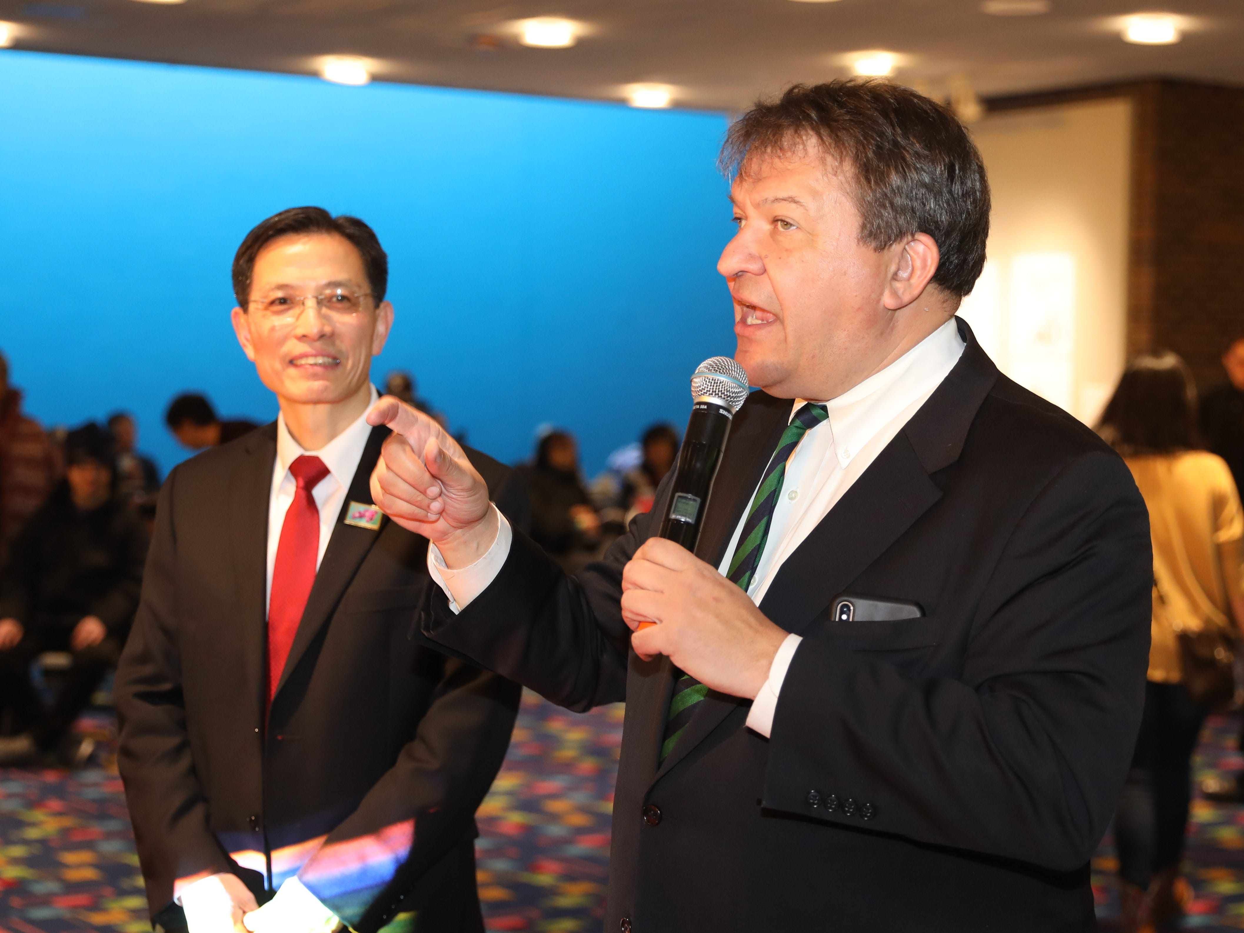 Kevin Ding, the president of WACA (Westchester Association of Chinese Americans), listens as Westchester County Executive George Latimer greets the guests, during the 30th Chinese New Year Festival, the Year of the Pig, sponsored by WACA, at The Performing Arts Center at Purchase College SUNY, Feb. 9, 2019.