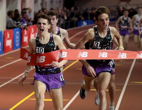 Matt Rizzo of Bronxville breaks the tape to win the New Balance Boys Mile during the 2019 Millrose Games at the New Balance Armory in Manhattan Feb. 9, 2019.