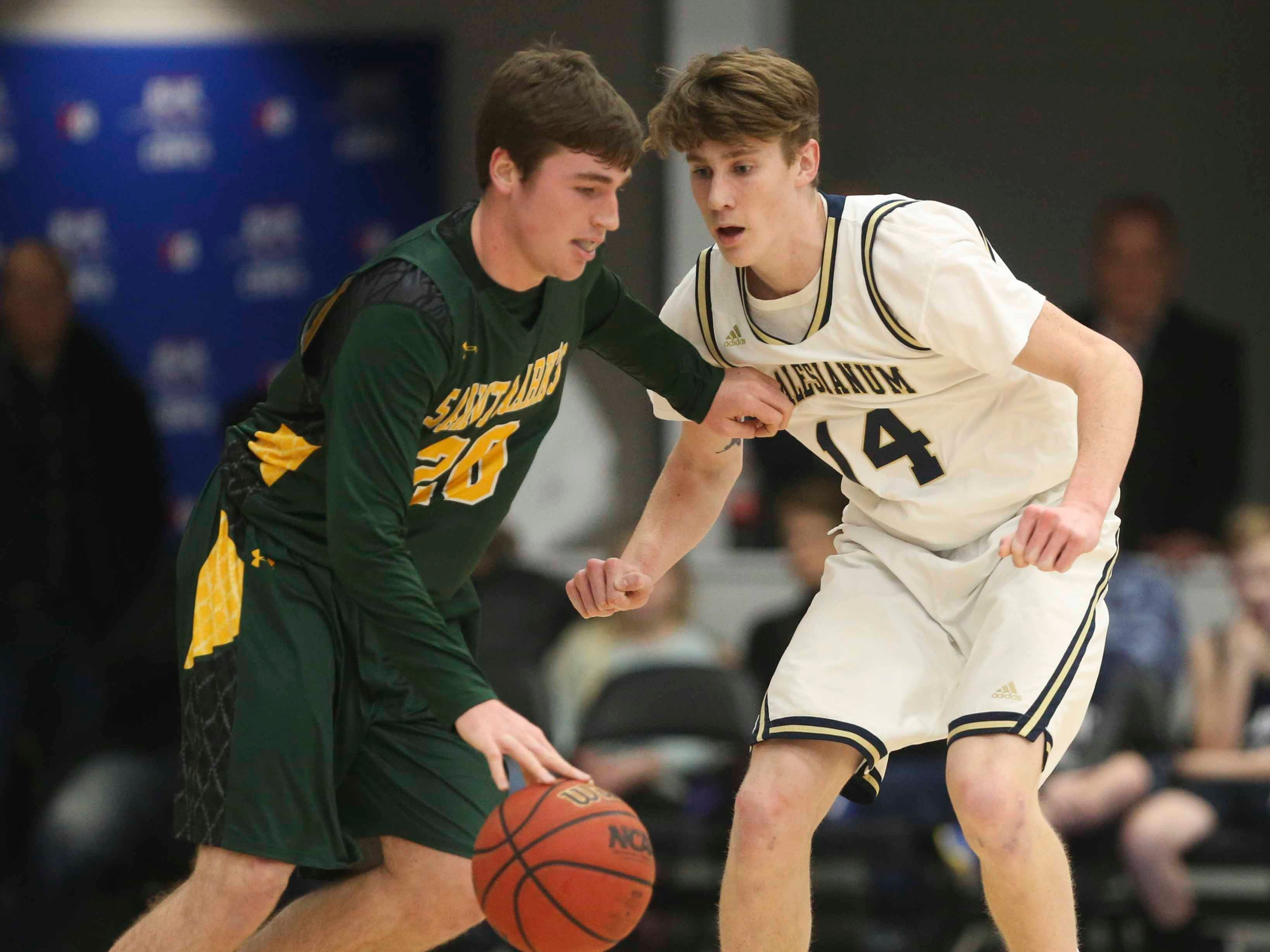 St. Mark's Eric Ludman (left) is guarded by Salesianum's Sean Regan in the SL24 Memorial Basketball Classic at the 76ers Fieldhouse in Wilmington Friday.