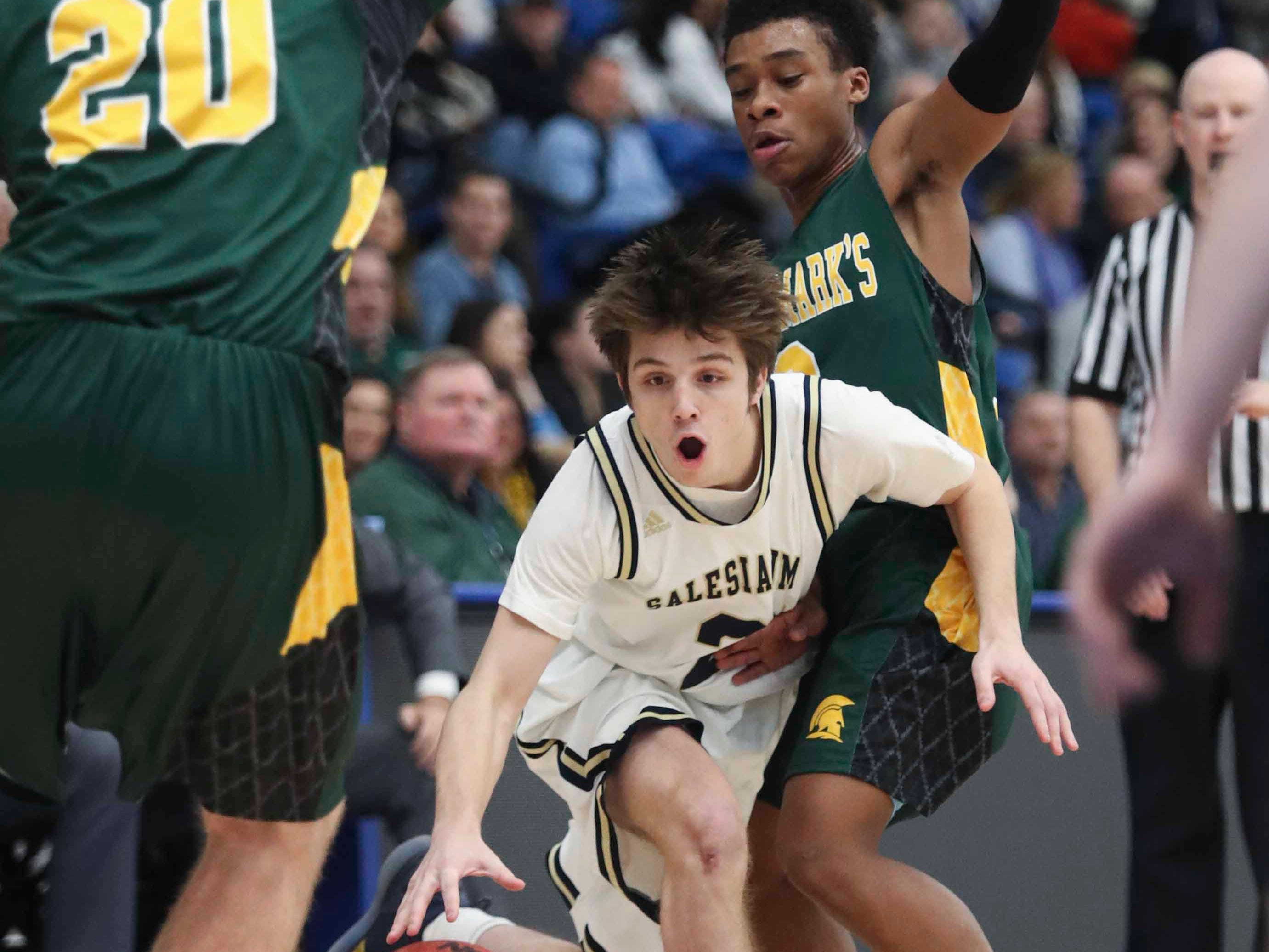 St. Mark's Eric Ludman (left) and Blaec Sanders try to stop Salesianum's Kevin Lutus in the SL24 Memorial Basketball Classic at the 76ers Fieldhouse in Wilmington Friday.