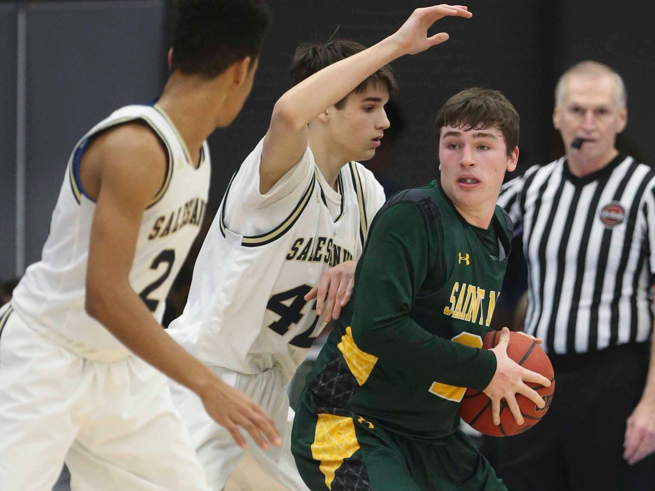 Salesianum's Ethan Hinds (left) and Dan Springman defend against St. Mark's Eric Ludman in the SL24 Memorial Basketball Classic at the 76ers Fieldhouse in Wilmington Friday.