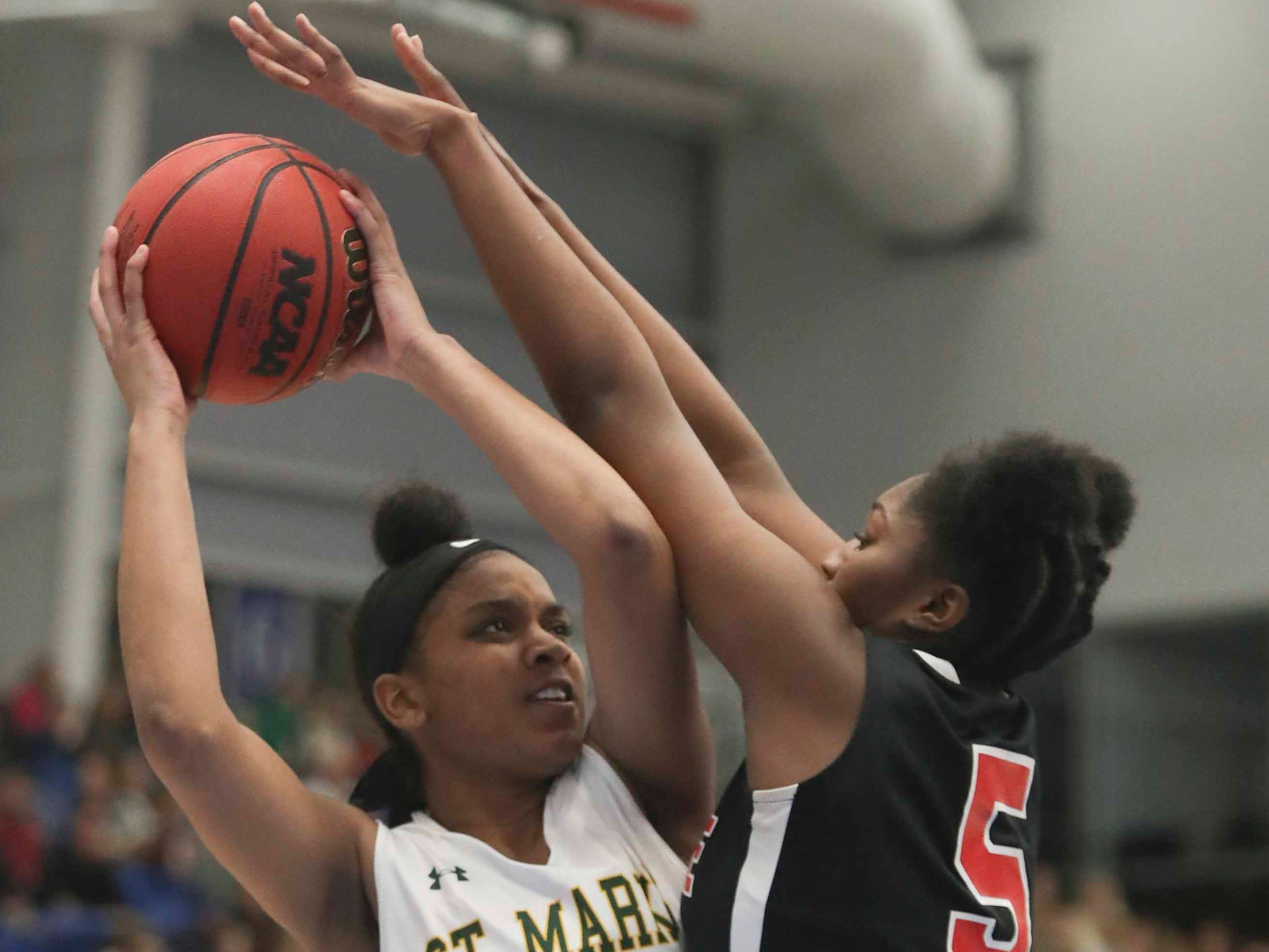 St. Mark's Aniyah Bond tries to pass against Ursuline's Kay Wulah in the SL24 Memorial Basketball Classic at the 76ers Fieldhouse in Wilmington Friday.