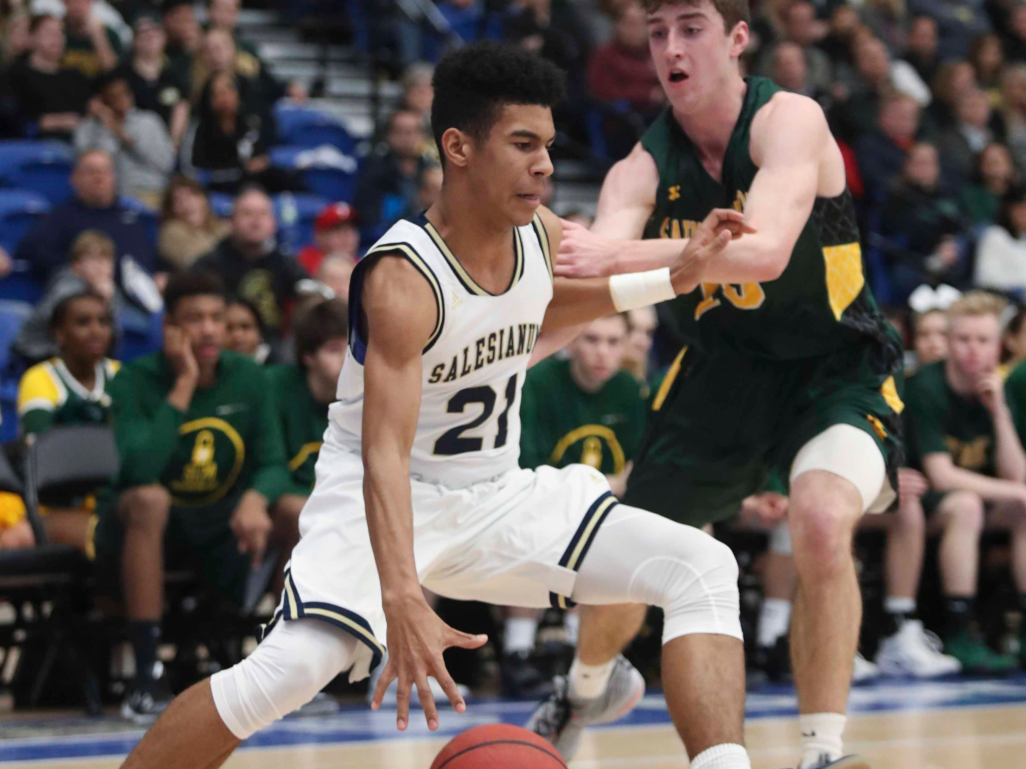 Salesianum's Ethan Hinds (left) moves against St. Mark's Victor Marcelo in the SL24 Memorial Basketball Classic at the 76ers Fieldhouse in Wilmington Friday.