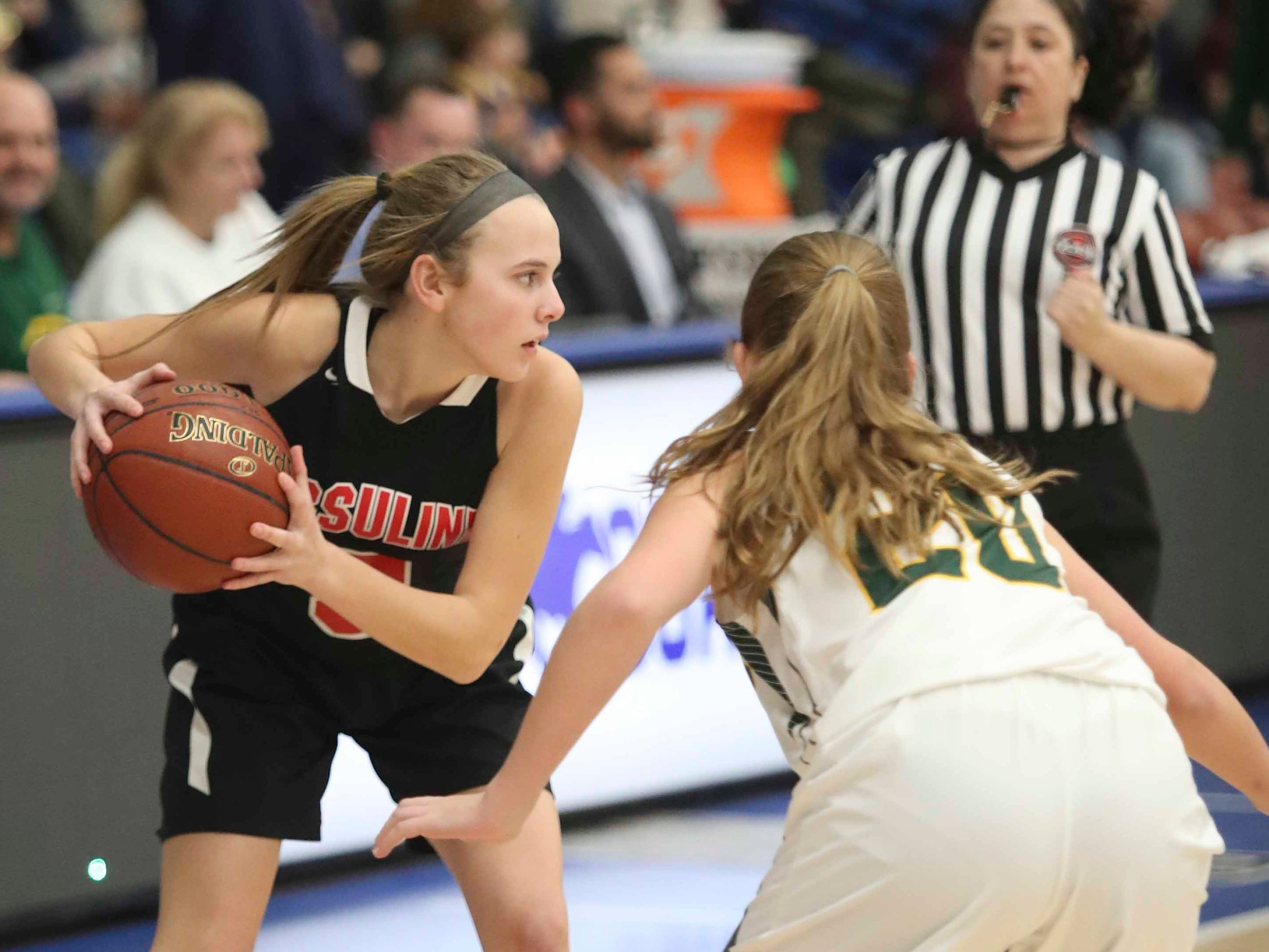Ursuline's Avery Burns looks past St. Mark's Madalyn Lenick in the SL24 Memorial Basketball Classic at the 76ers Fieldhouse in Wilmington Friday.
