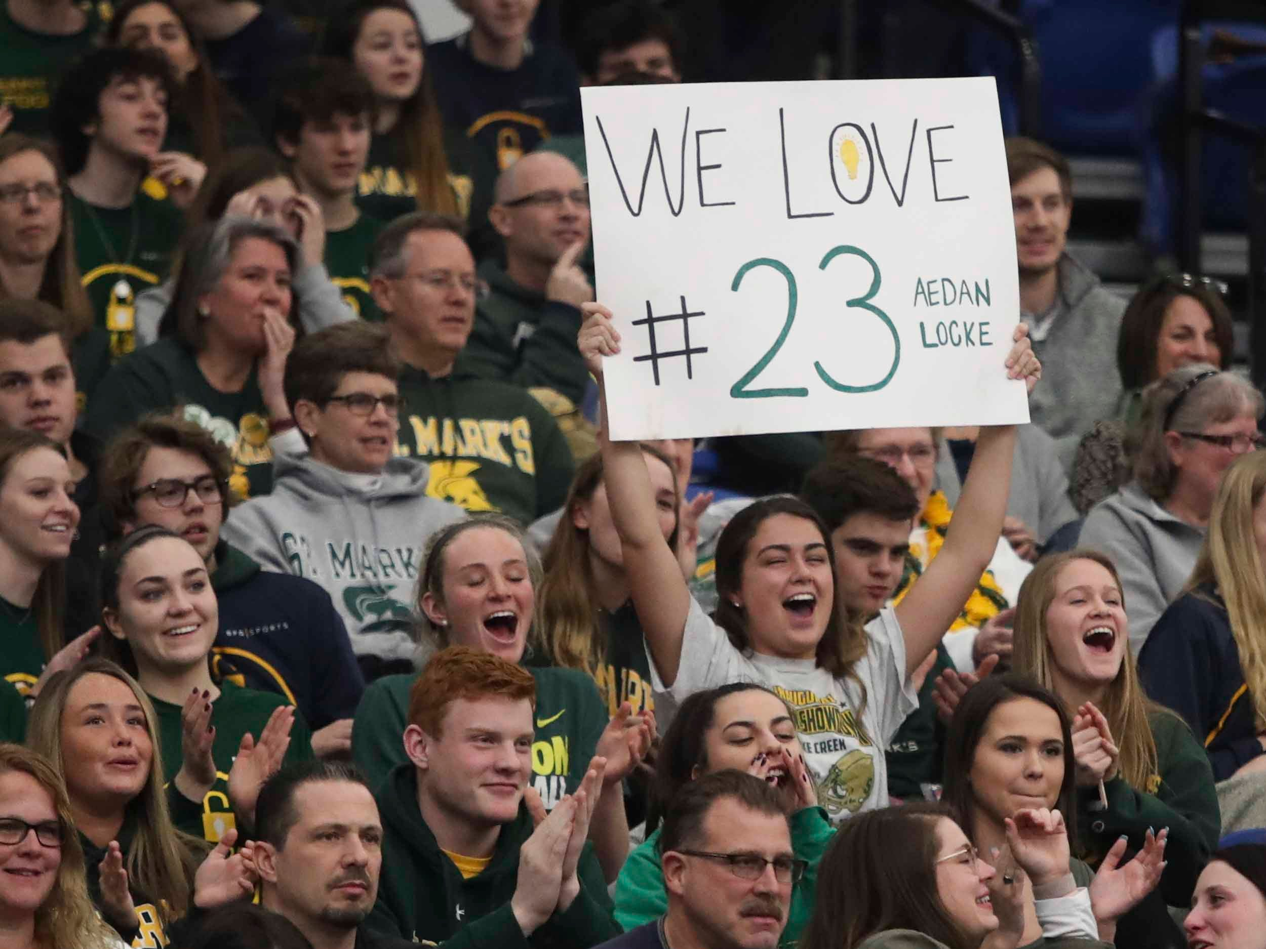 Supporters of Aeden Locke, brother of Sean Locke, cheer him during the SL24 Memorial Basketball Classic at the 76ers Fieldhouse in Wilmington Friday.