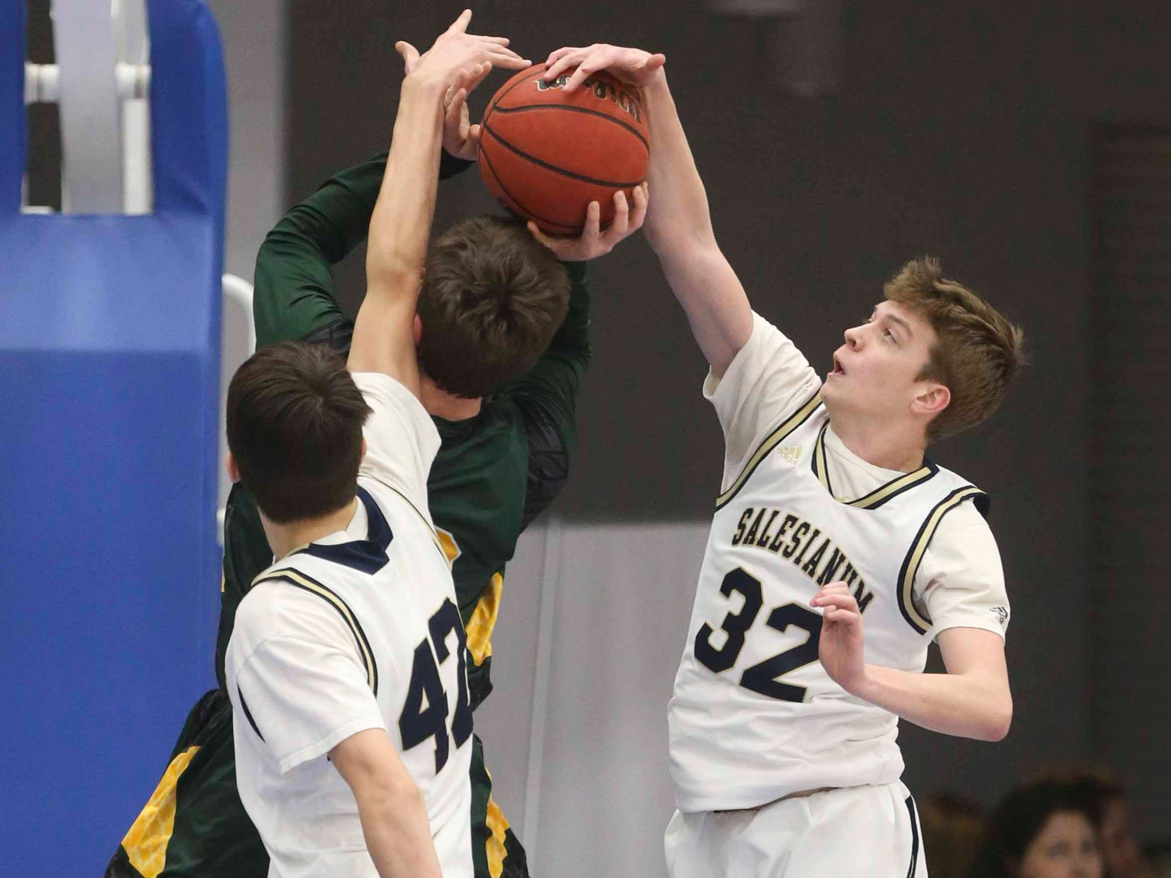 Saesianum's Thomas Montooth (32) gets a block in the SL24 Memorial Basketball Classic at the 76ers Fieldhouse in Wilmington Friday.