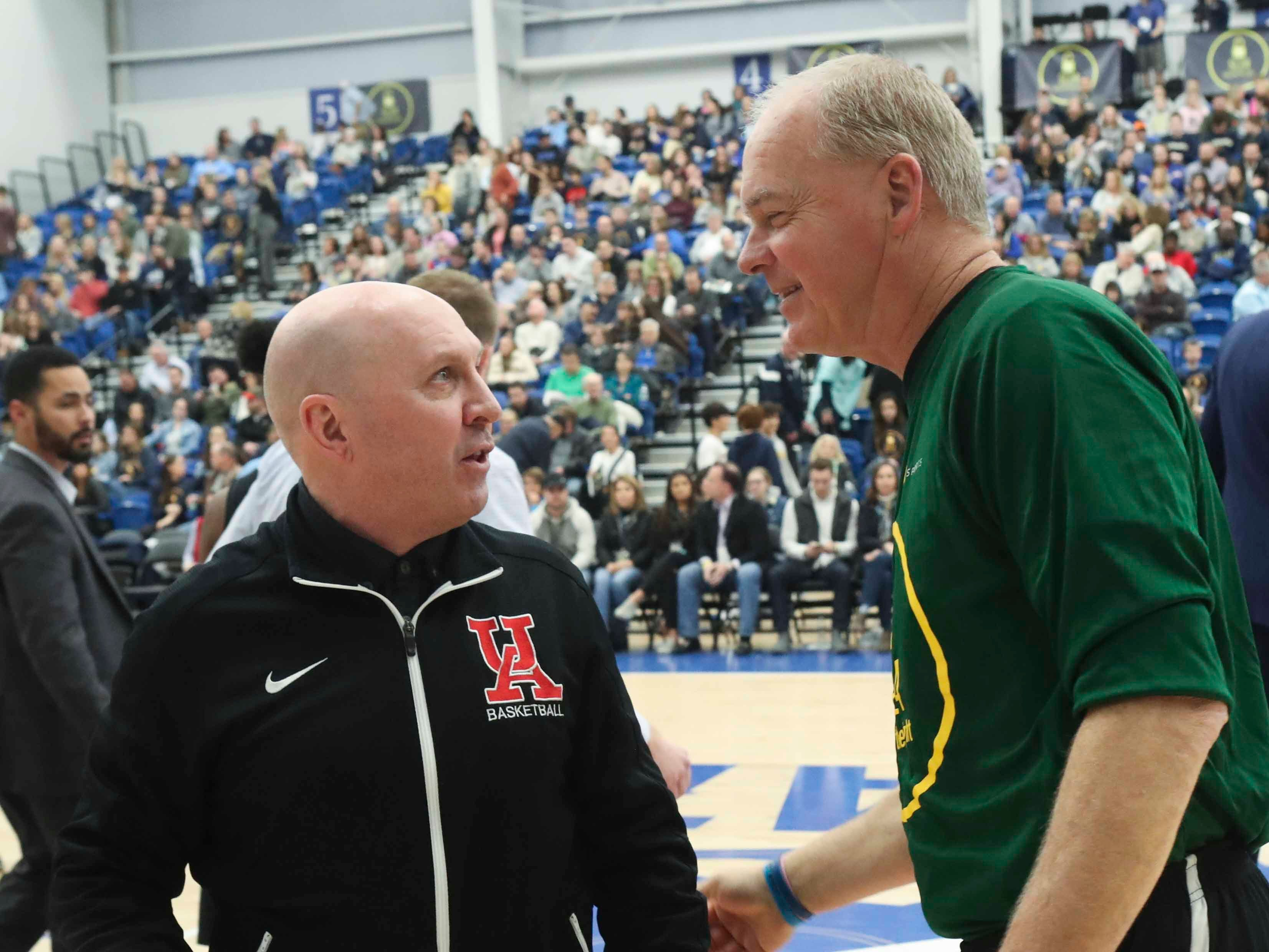 Ursuline coach John Noonan greets his St. Mark's counterpart Jim Freel after their teams competed in the SL24 Memorial Basketball Classic at the 76ers Fieldhouse in Wilmington Friday.