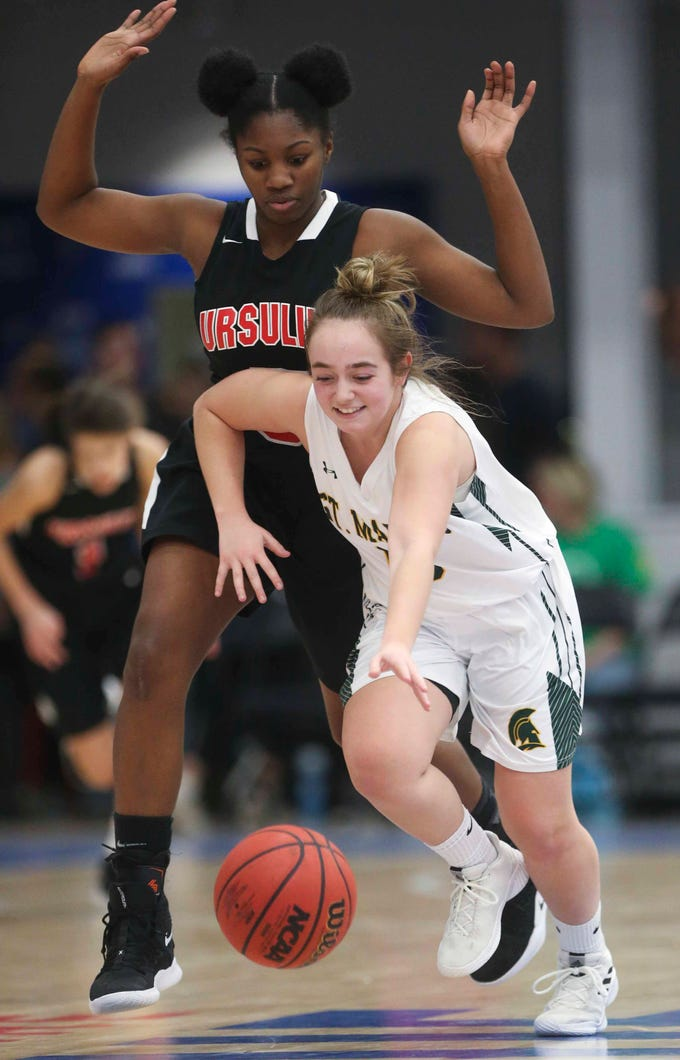 St. Mark's Ava Berardi gets the ball past Ursuline's Kay Wulah in the SL24 Memorial Basketball Classic at the 76ers Fieldhouse in Wilmington Friday.