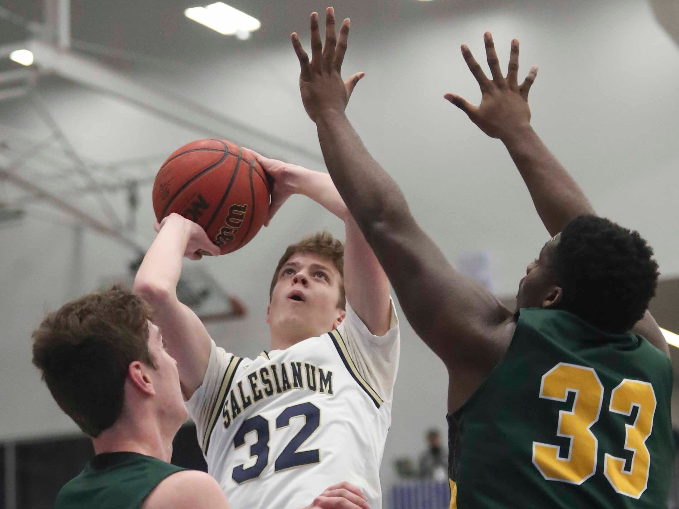 Salesianum's Thomas Montooth shoots against St. Mark's Victor Marcelo (left) and Devon Jones in the SL24 Memorial Basketball Classic at the 76ers Fieldhouse in Wilmington Friday.