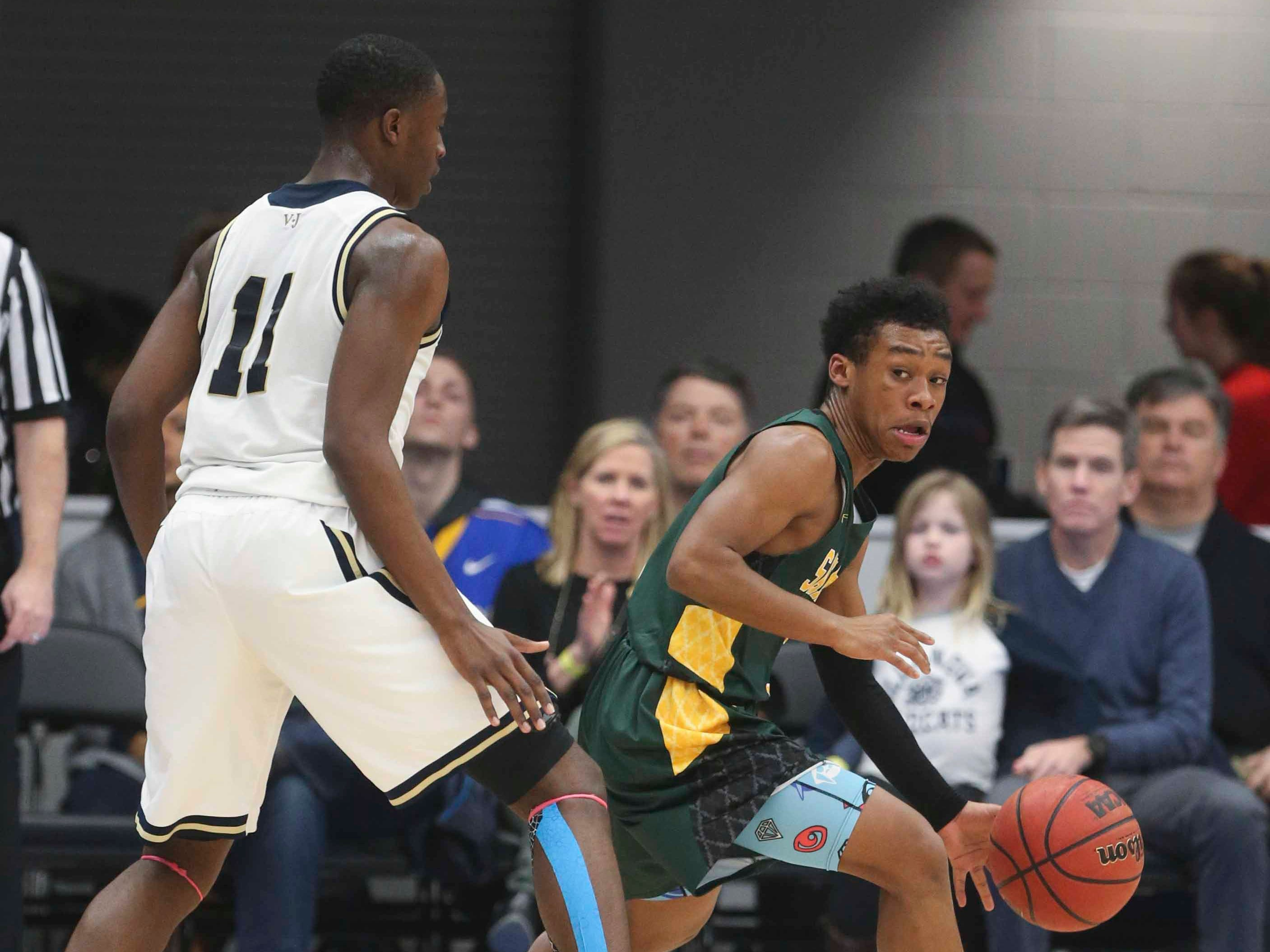 St.Mark's Blaec Sanders (right) maneuvers against Salesianum's Darnell Vaughn in the SL24 Memorial Basketball Classic at the 76ers Fieldhouse in Wilmington Friday.