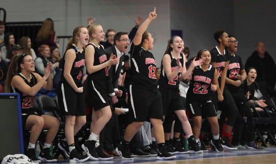 The Ursuline bench cheers one of its own late in the Raiders' 48-31 win over St. Mark's at the SL24 Memorial Basketball Classic at the 76ers Fieldhouse in Wilmington last Friday.
