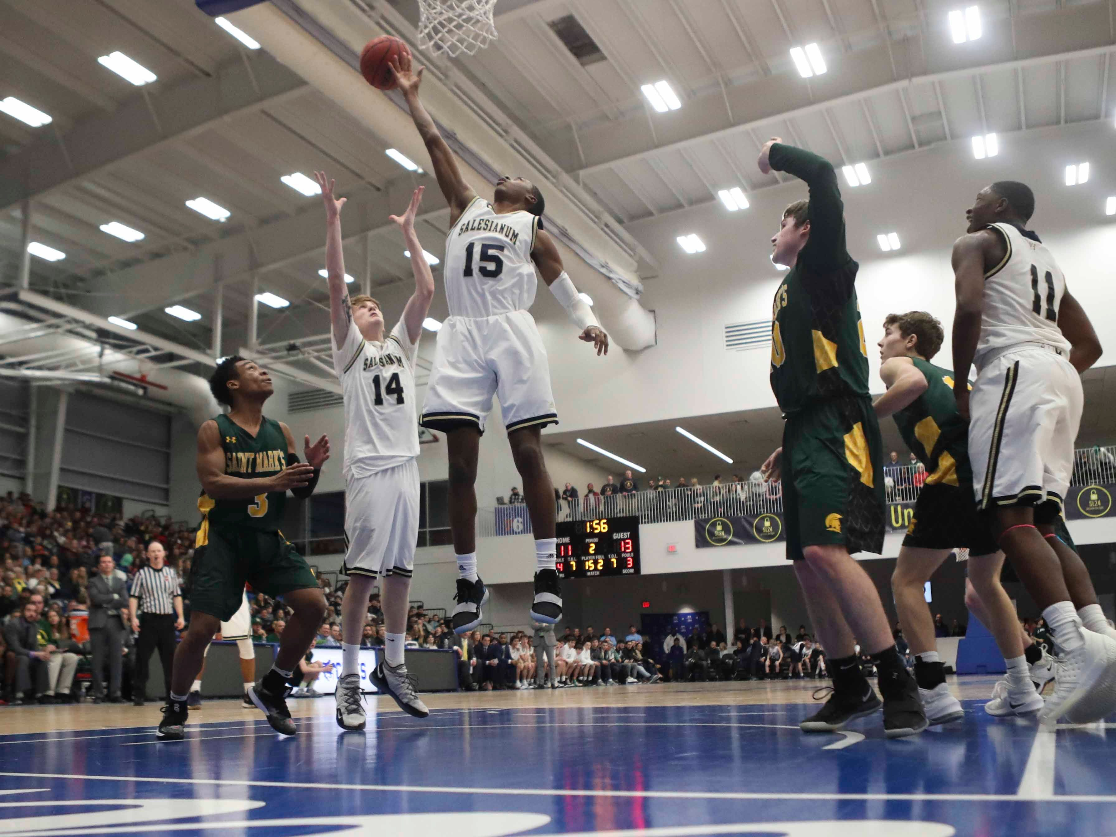Salesianum's Sean Regan (14) and Rasheed Caulk extend for a rebound in the SL24 Memorial Basketball Classic at the 76ers Fieldhouse in Wilmington Friday.