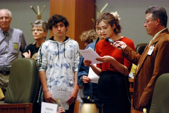 In this Monday, Feb. 4, 2019, photo, high school student Sophia Lussiez, 17, of Santa Fe, N.M., second from right, testifies in support of proposals for new gun safety regulations in the state, in Santa Fe, N.M. The New Mexico Legislature is considering a bill that would temporarily restrict firearms access for people considered to be at risk to themselves or others. Various states are considering similar regulations since last year's mass shooting at a Florida high school. (AP Photo/Morgan Lee)