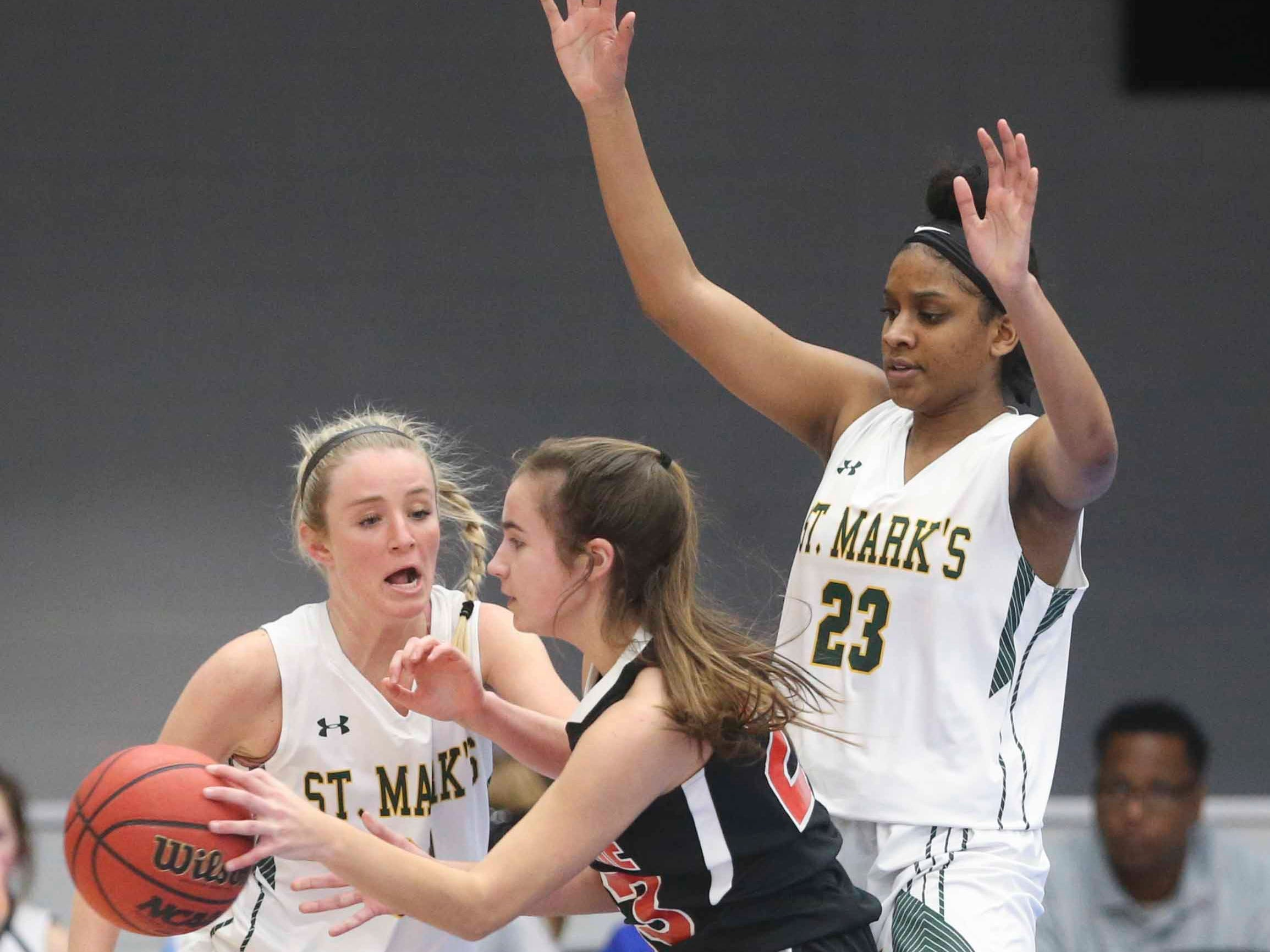 Ursuline's Emma Raftovich works against St. Mark's Lindsey Oberhausen (left) and Aniyah Bond and in the SL24 Memorial Basketball Classic at the 76ers Fieldhouse in Wilmington Friday.