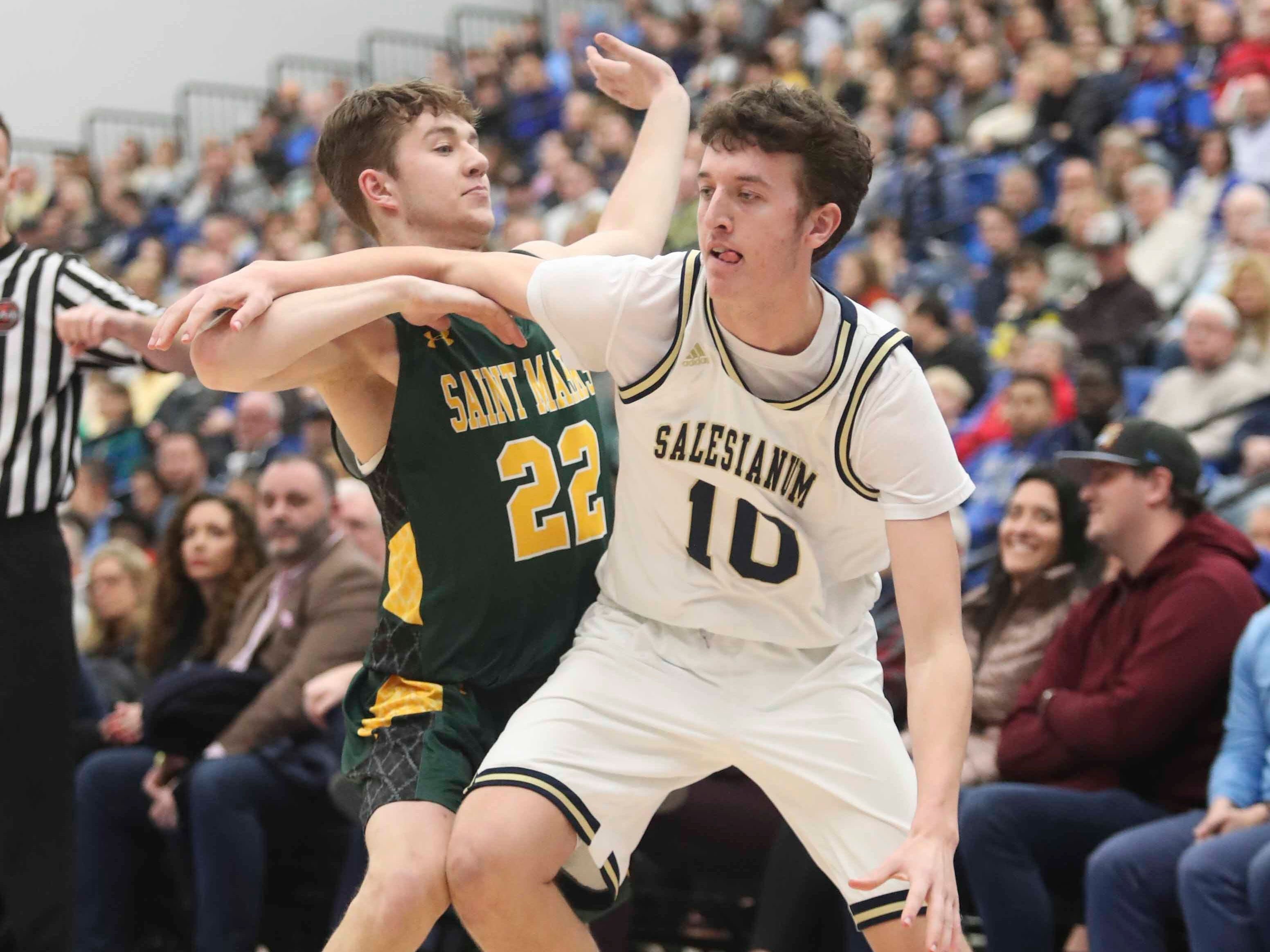 Salesianum's Jack Brown (right) tries to get past St. Mark's Michael Williams in the SL24 Memorial Basketball Classic at the 76ers Fieldhouse in Wilmington Friday.