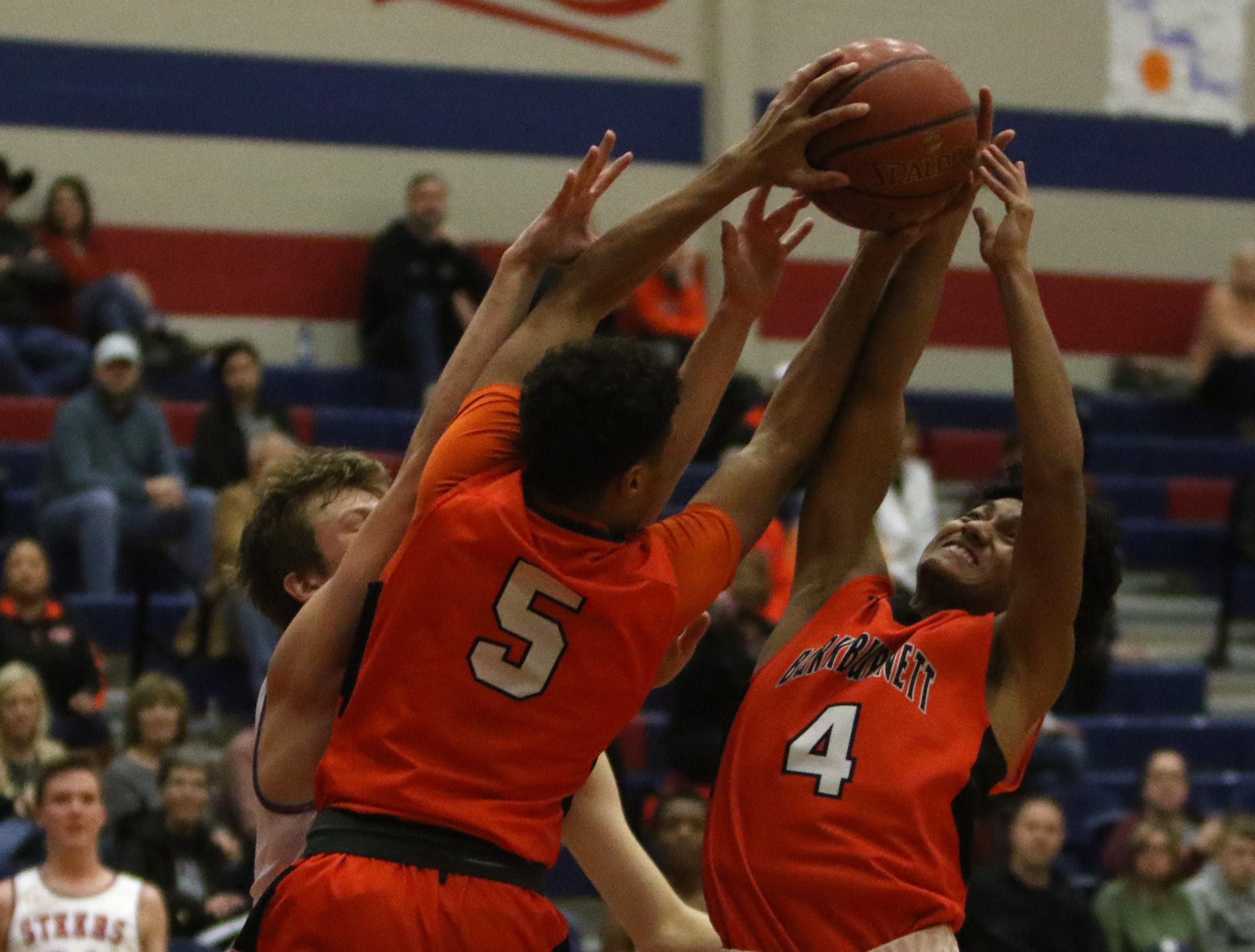 Burkburnett's Jaevion Moreland (4) and Jaden Arnold (5) reach for the rebound in the game against Graham Friday, Feb. 8, 2019, in Graham. The Steers defeated the Bulldogs 75-70.