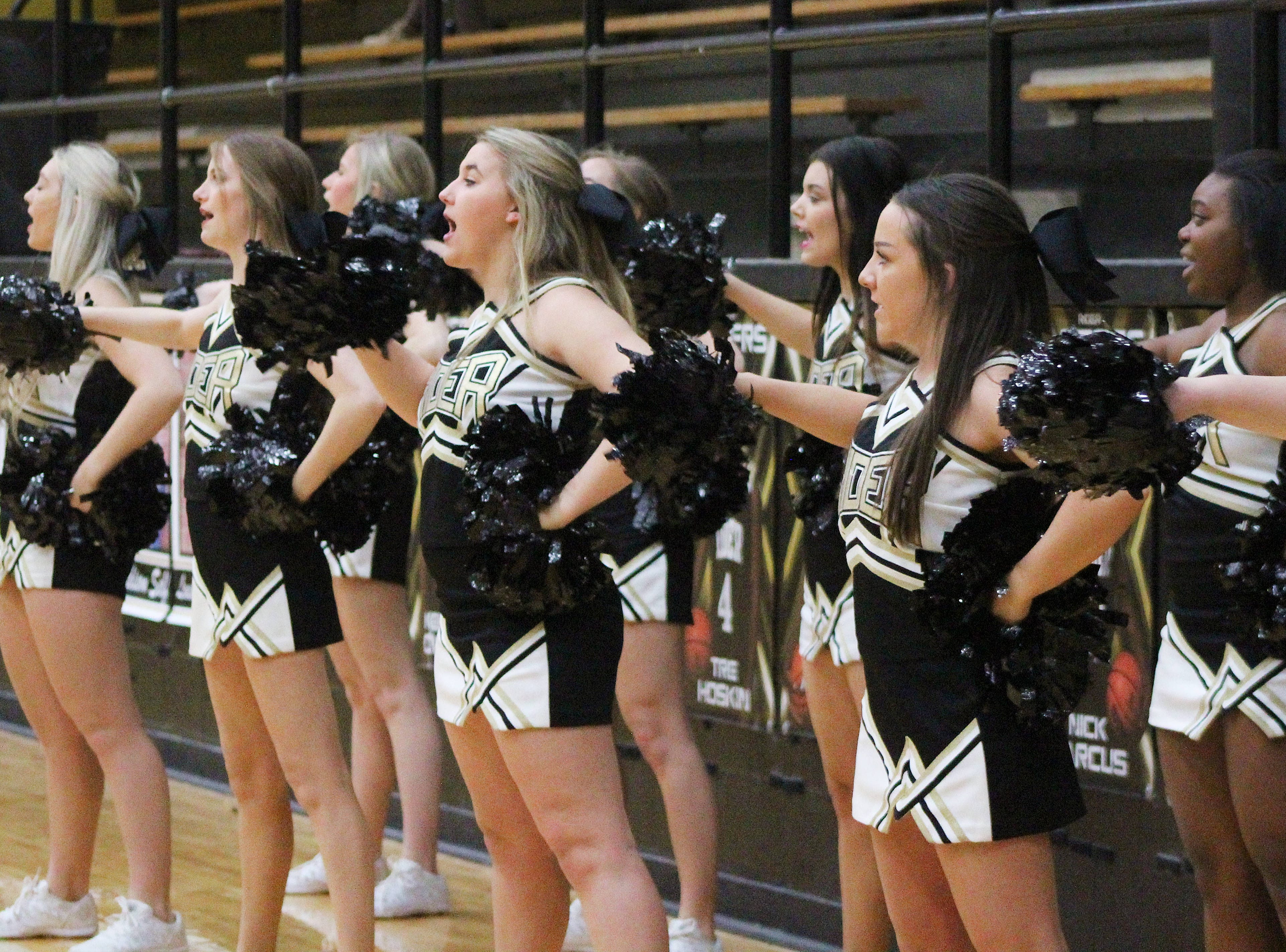 Rider cheerleaders encourage the team from the sideline as they defeat Abilene Wylie 54-37.