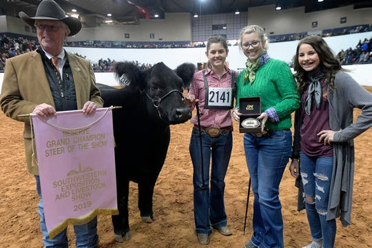 Saige Martin (2141) stands with her Reserve Grand Champion steer King during the Fort Worth Stock Show at Will Rogers Memorial Center in Fort Worth, Texas, Friday, Feb. 8, 2019.