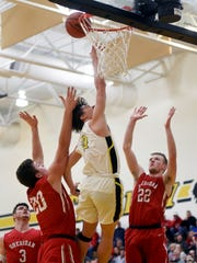 Matt King flies in for a layup during Tri-Valley's 62-57 win against Sheridan on Friday night in Dresden. King scored 15 points in his game back from injury.