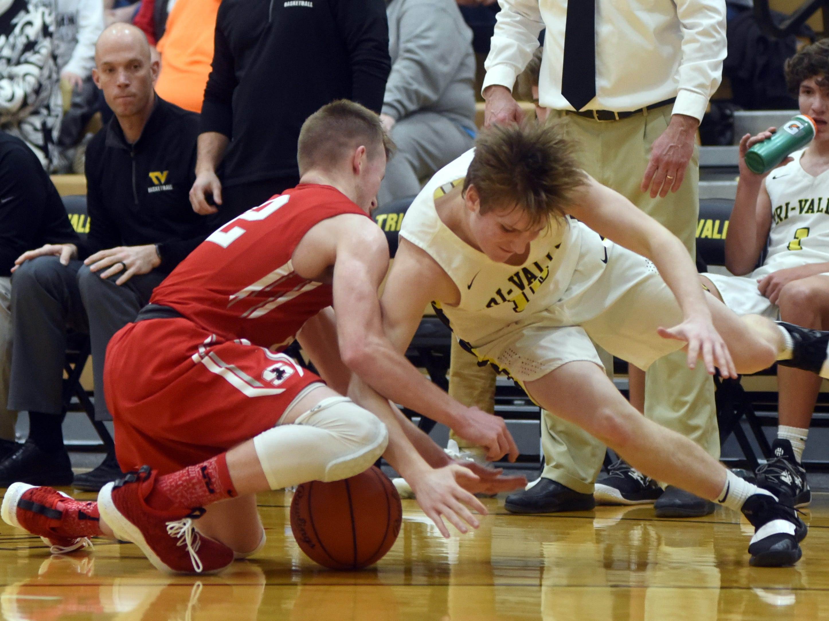 Sheridan's Landen Russell, left, and Tri-Valley's Jack Lyall go after a loose ball on Friday night in Dresden.