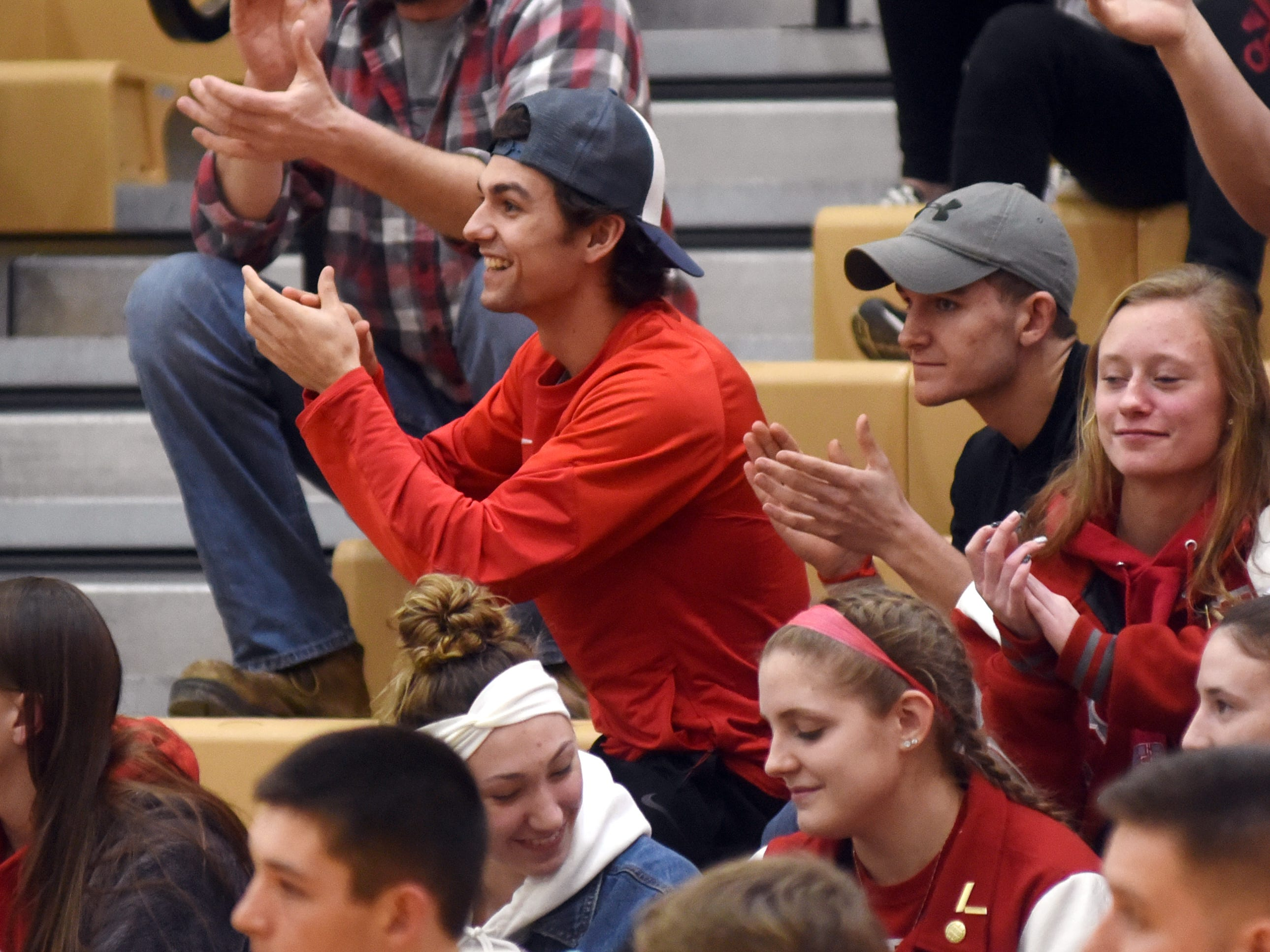 Sheridan senior Reece Trowbridge cheers on the basketball team during its game against Tri-Valley on Friday night in Dresden.