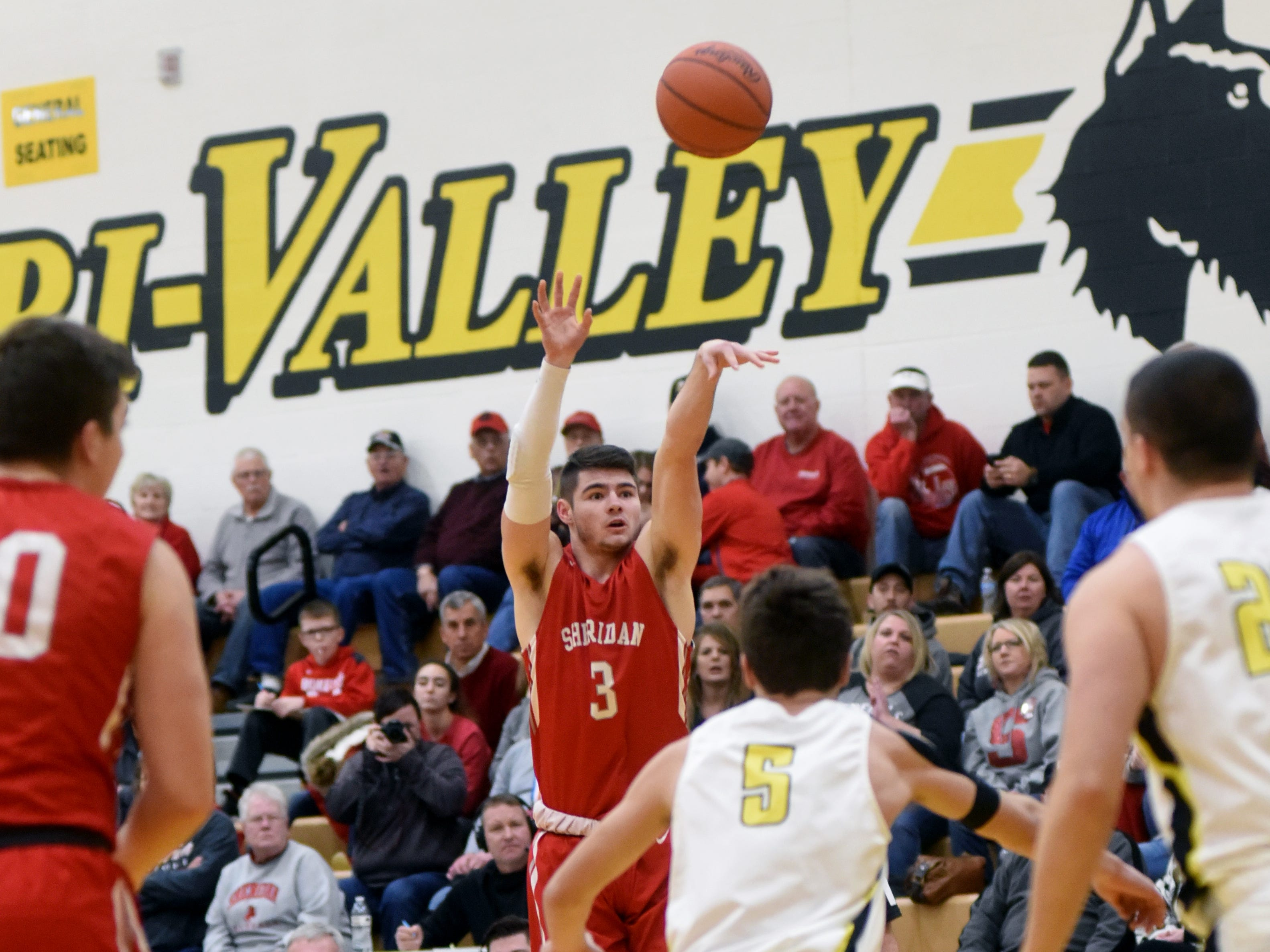 Ethan Heller shoots a 3 against Tri-Valley on Friday night in Dresden.