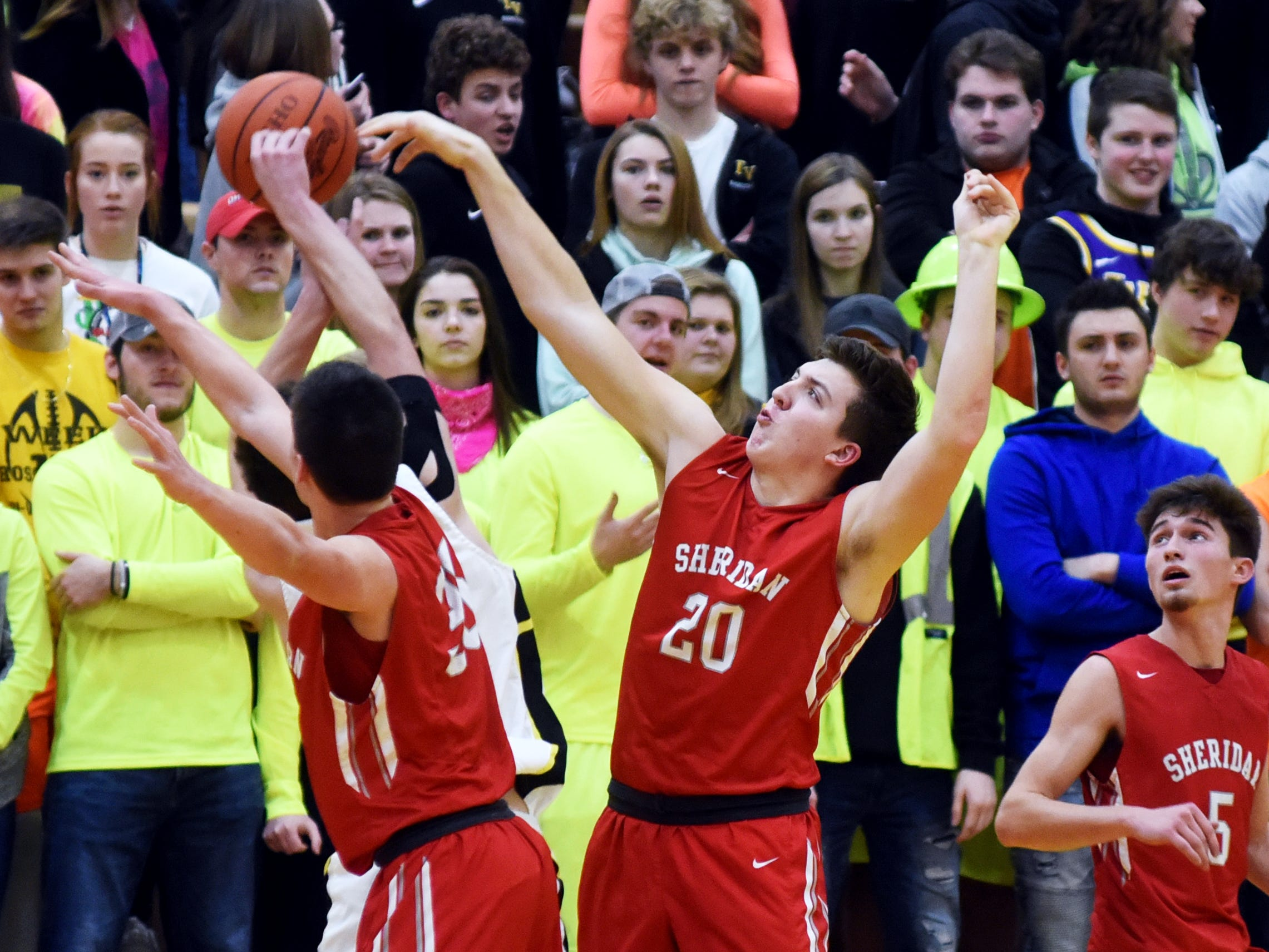 Sheridan's Shay Taylor, left, and Adam Boyle trap a Tri-Valley player on the baseline on Friday night in Dresden.