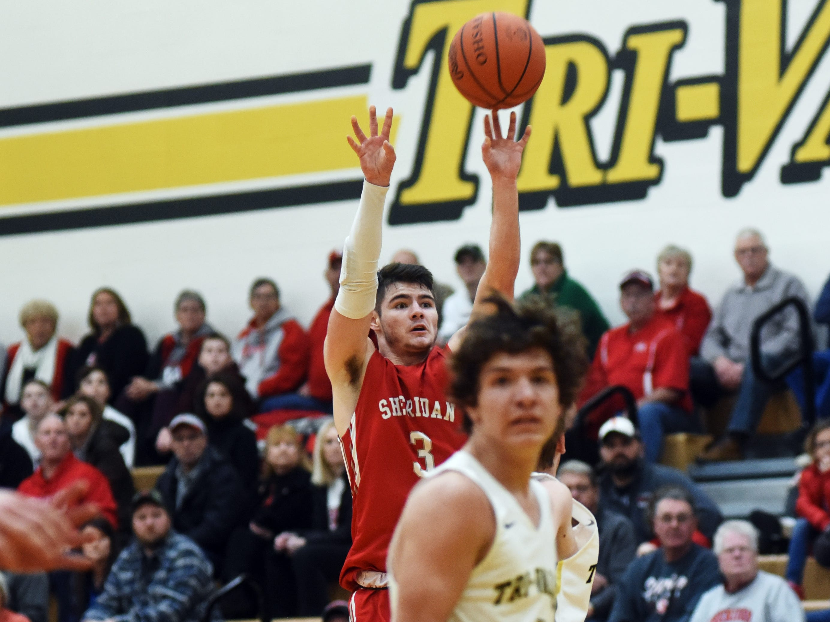 Sheridan's Ethan Heller hoists a jumper against Tri-Valley on Friday night in Dresden.