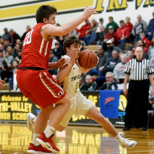 Skye Bryan drives into the lane against Sheridan's Adam Boyle during Tri-Valley's 62-57 win on Friday night in Dresden. Bryan scored a team-high 16 points.
