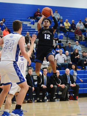 Cory Norris shoots a jumper during Zanesville's 39-36 loss to Cambridge on Friday night. The Blue Devils fell to 7-12.