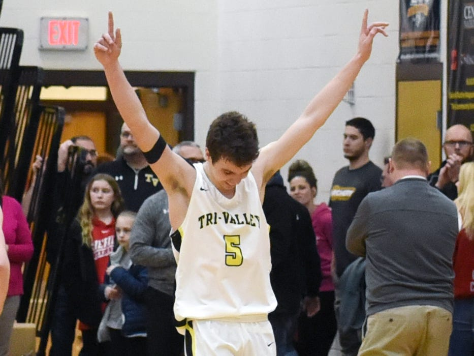 An elated Keaton Williams walks off the floor following Tri-Valley's 62-57 win against Sheridan on Friday night in Dresden.