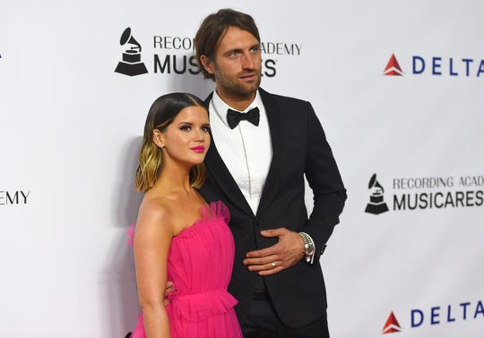 Maren Morris, left, and Ryan Hurd arrive at MusiCares Person of the Year honoring Dolly Parton on Friday, Feb. 8, 2018, at the Los Angeles Convention Center. (Photo by Jordan Strauss/Invision/AP) ORG XMIT: CADC153