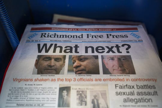 A local newspaper the Richmond Free Press, with a front page featuring top Virginia state officials embroiled in controversies, sits for sale in a newsstand near the Virginia State Capitol, Feb. 9, 2019 in Richmond, Va.  Virginia state politics are in a state of upheaval, with Governor Ralph Northam, State Attorney General Mark Herring, both Democrats, and Republican Senate Majority Leader Tommy Norment involved with past uses associations with blackface and Lt. Governor Justin Fairfax, a Democrat, accused of sexual misconduct by two women.