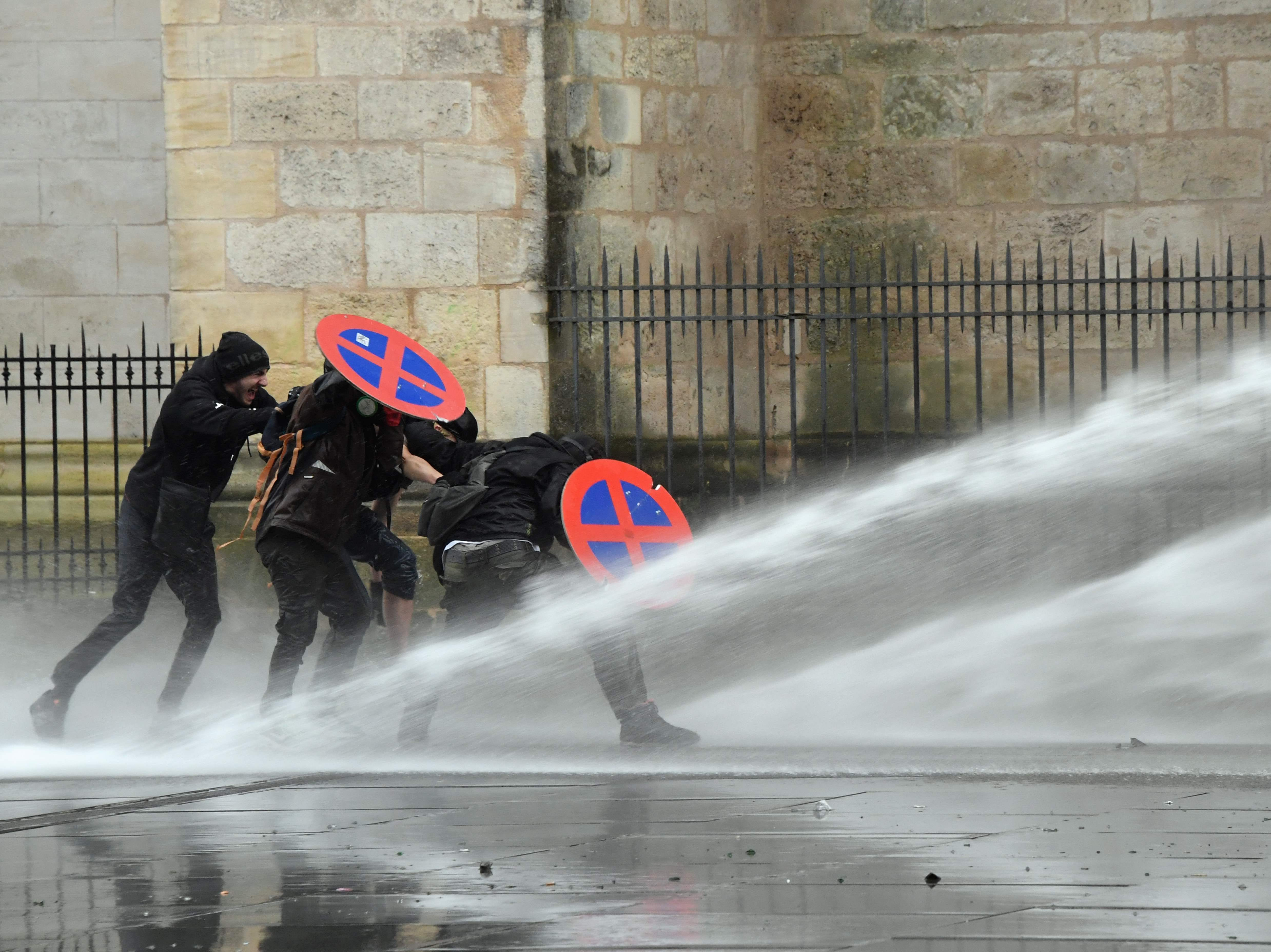 A riot police vehicle uses a water cannon to disperse protesters during a yellow vests (Gilets jaunes) rally, on Feb. 9, 2019 in Bordeaux, during the 13th consecutive Saturday of demonstrations.
