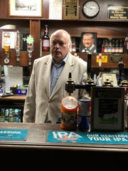 Richard Willis, owner of the Romford Snooker Club, stands behind the club's bar on Feb. 4, 2019.