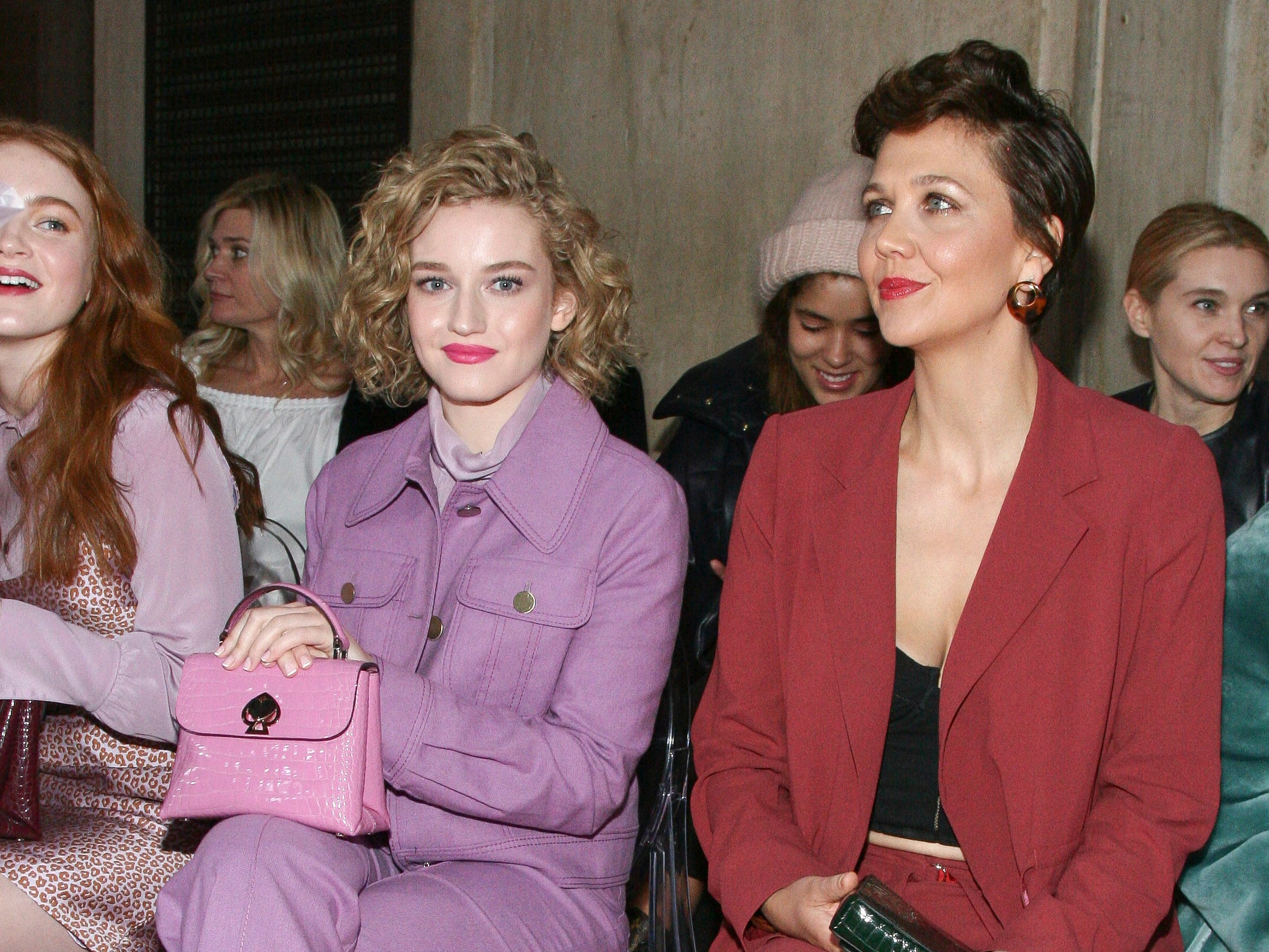 Julia Garner, left, and Maggie Gyllenhaal, right, attend the NYFW Fall/Winter 2019 Kate Spade fashion show at the Cipriani's on Friday, Feb. 8, 2019, in New York. (Photo by Andy Kropa/Invision/AP) ORG XMIT: NYAK101