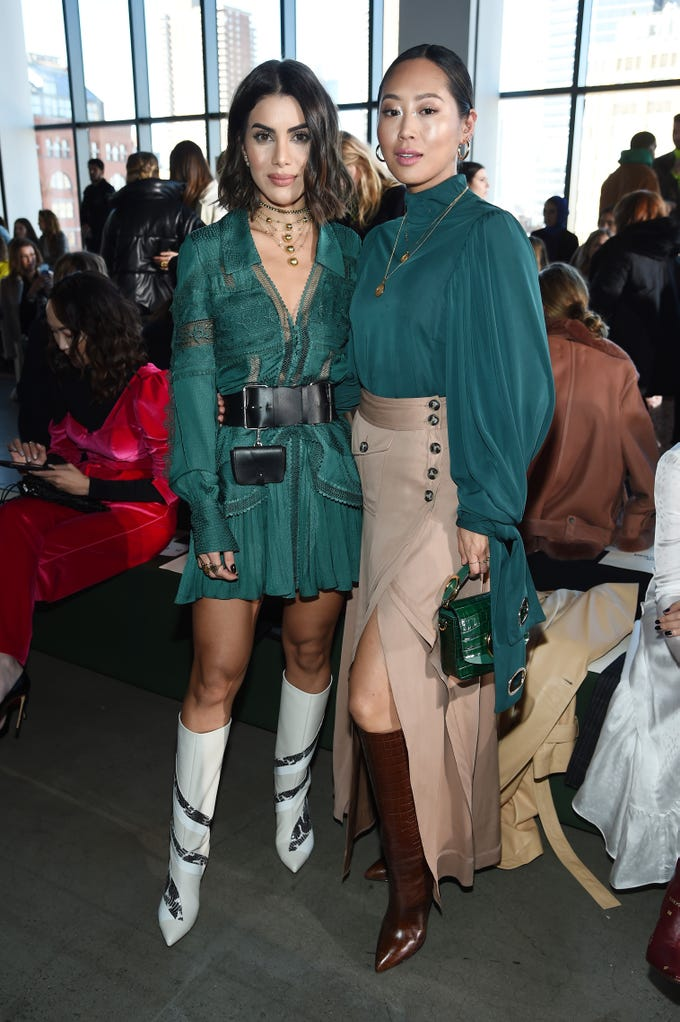 NEW YORK, NY - FEBRUARY 09: Camila Coelho (L) and Aimee Song attend the Self-Portrait front row during New York Fashion Week: The Shows at Gallery I at Spring Studios on February 9, 2019 in New York City.  (Photo by Dimitrios Kambouris/Getty Images for NYFW: The Shows) ORG XMIT: 775290796 ORIG FILE ID: 1096566410