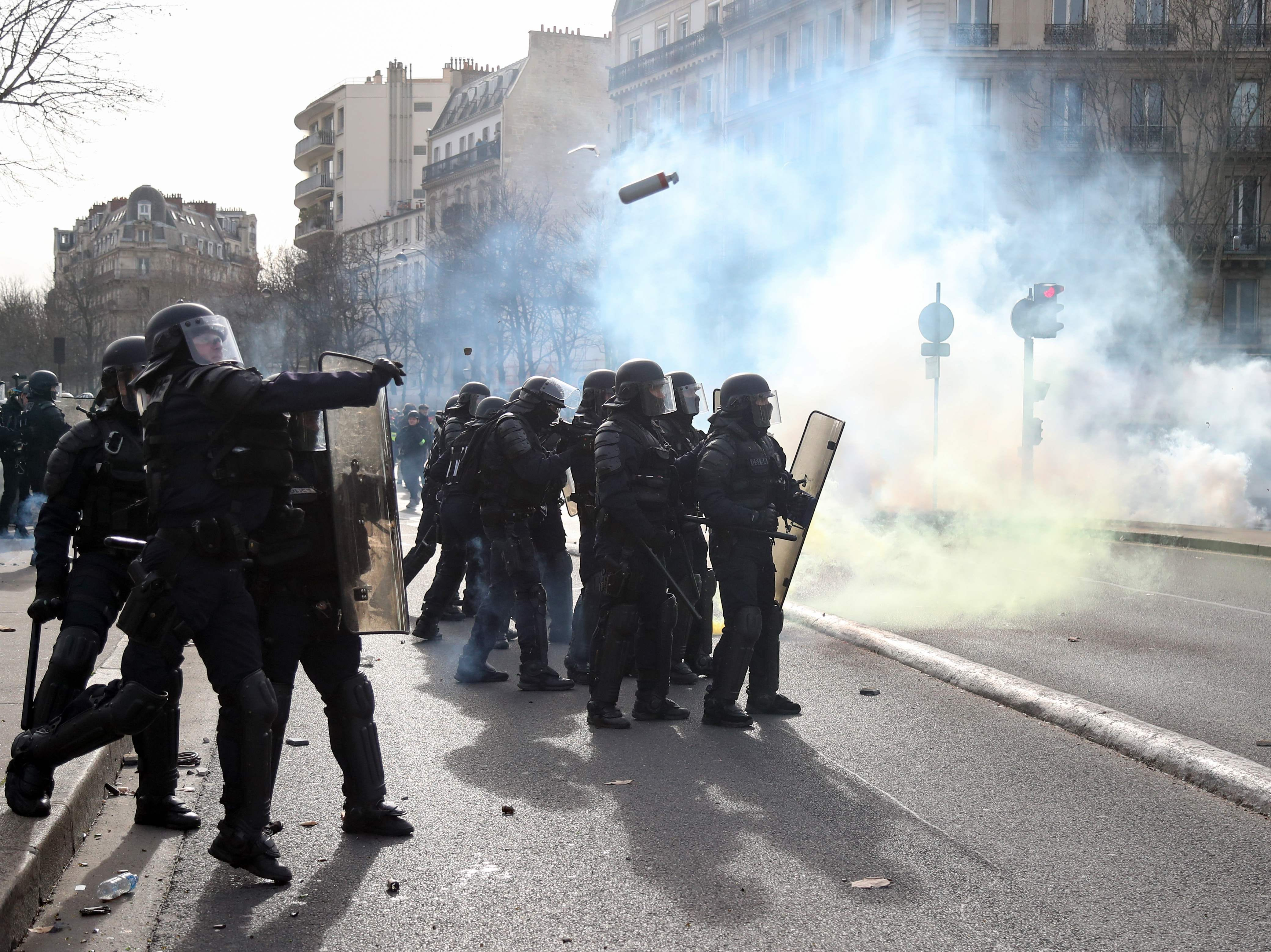 Police officers throw tear gas to protesters during the 13th consecutive Saturday demonstration called by the 'Yellow Vests' (Gilets Jaunes) movement in Paris, on Feb. 9, 2019. The 'Yellow Vest' movement in France originally started as a protest about planned fuel hikes but has morphed into a mass protest against French President's policies and top-down style of governing.