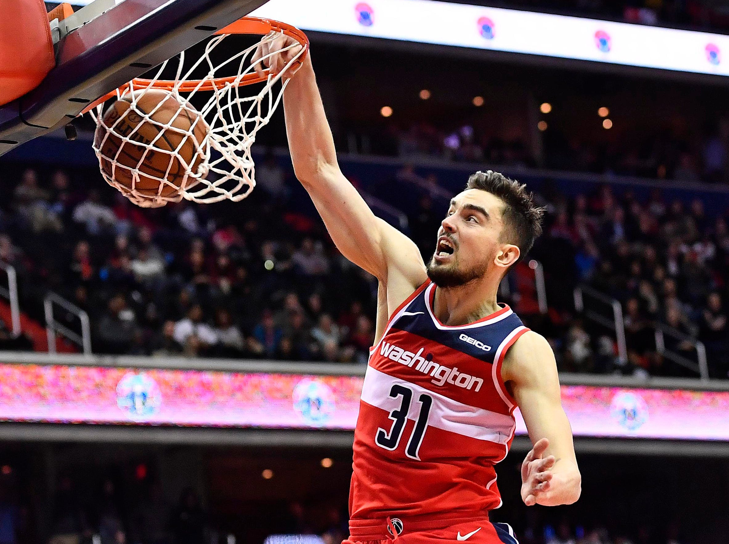 Feb. 8: Washington Wizards guard Tomas Satoransky dunks the ball against the Cleveland Cavaliers during the second half at Capital One Arena.