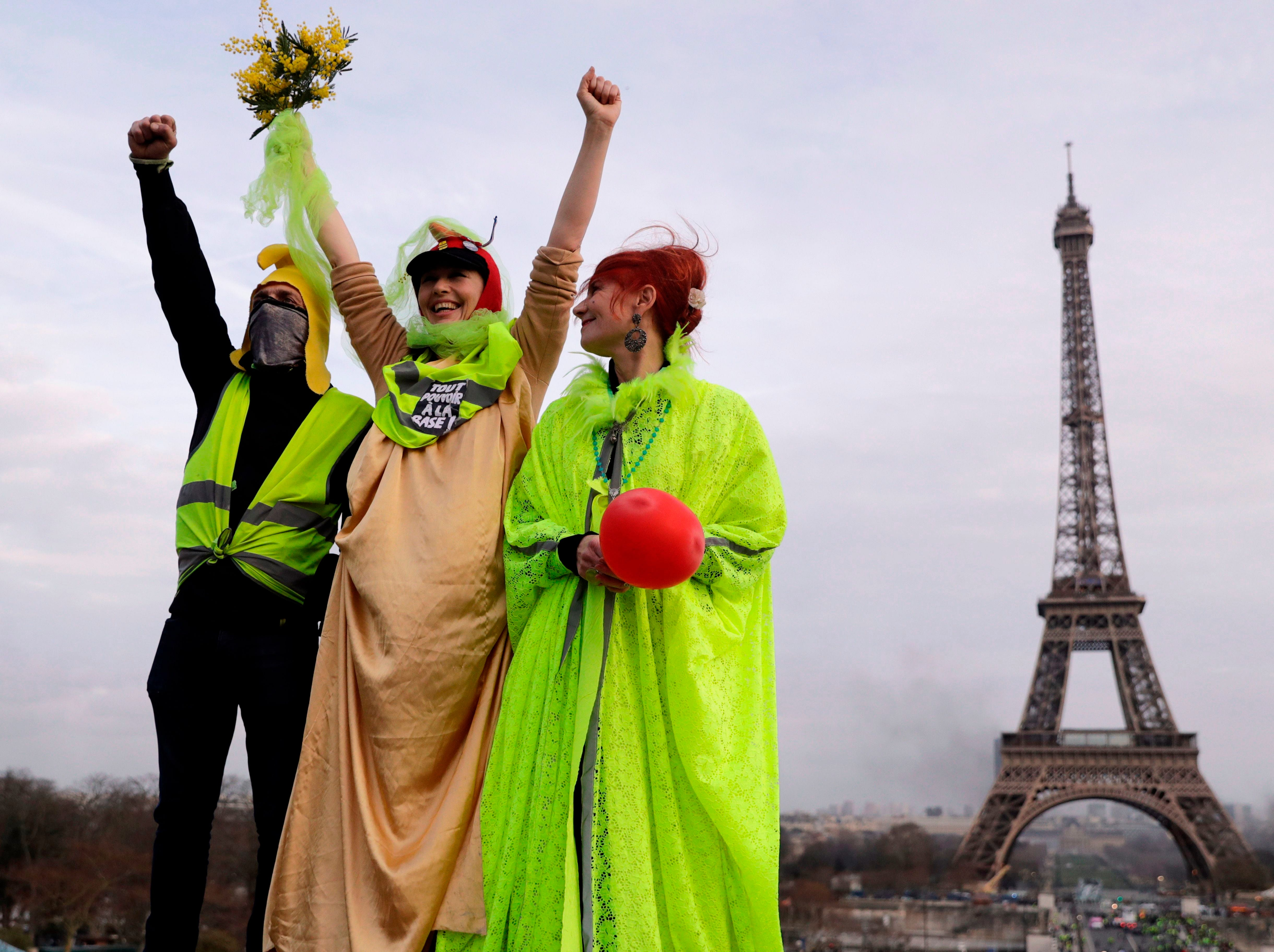 Yellow Vest protesters stand in front of the Eiffel Tower on Feb. 9, 2019 in Paris, during the 13th consecutive Saturday of demonstrations.