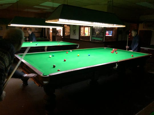 Ian Day, a long way left, and Syl Goldberg, a long way exquisite, play a game of snooker on the Romford Snooker Club, outside of London on Feb. four, 2019.