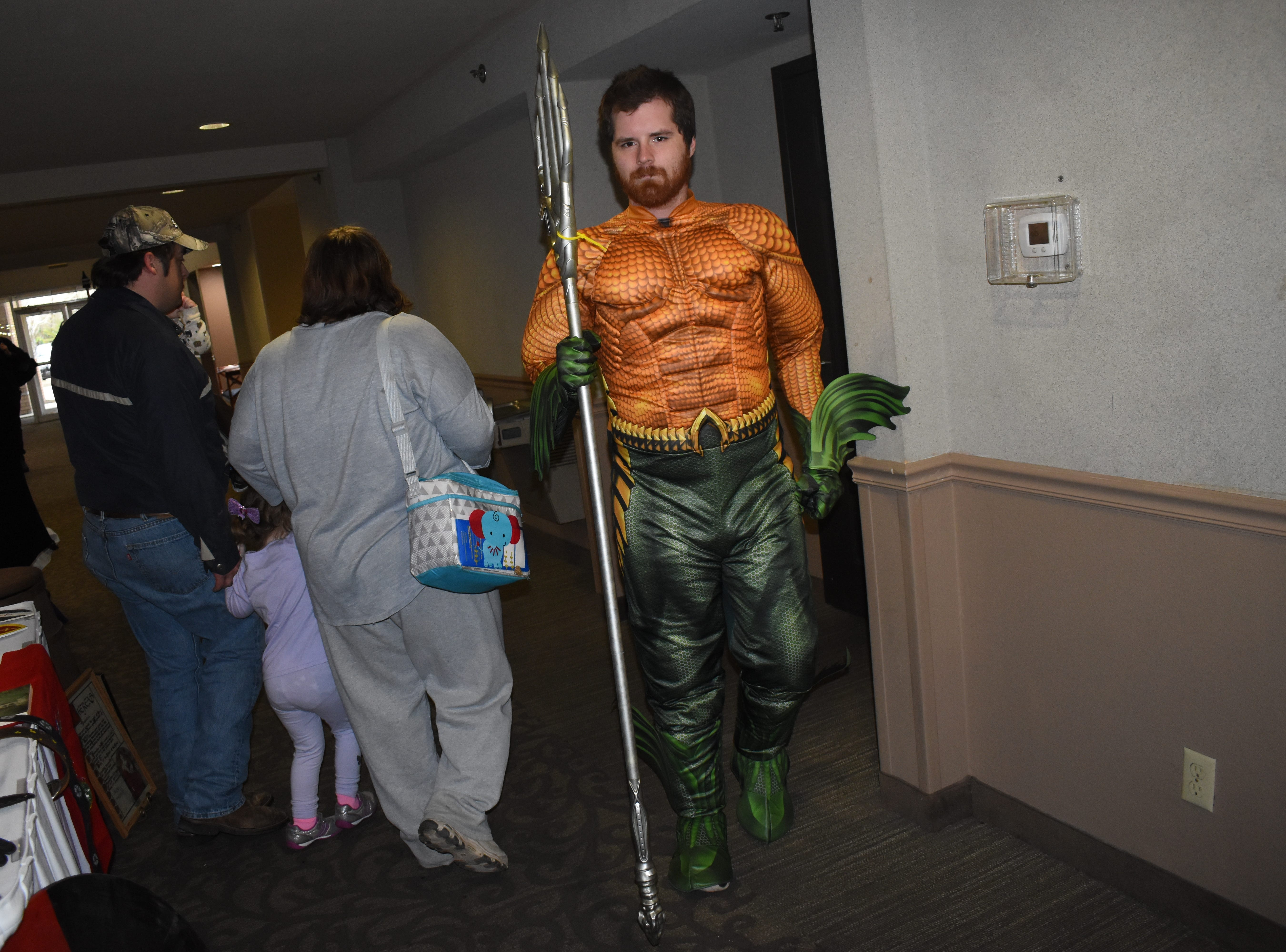Dressed as th DC Comics' superhero Aquaman, Stefan Stolmeier walks around Creative Con 2019 Saturday, Feb. 9, 2019 at the Best Western Inn & Suites on North MacArthur Drive. Creative Con is sponsored by the Rapides Parish Library and caters to all creative interests such as books, cosplay, gaming, art, steampunk, 3D printing and more. Among the panel discussions were a talk about acting and the acting business by Alexandria actor and stylist Dan Forest, and  discussions about magic by magician David Lebeouf, Doctor Who by Jack Sawtelle and writing by Christee Atwood. Other events included a costume contest, trivia games and play fighting by the Society for Creative Anarchronism.