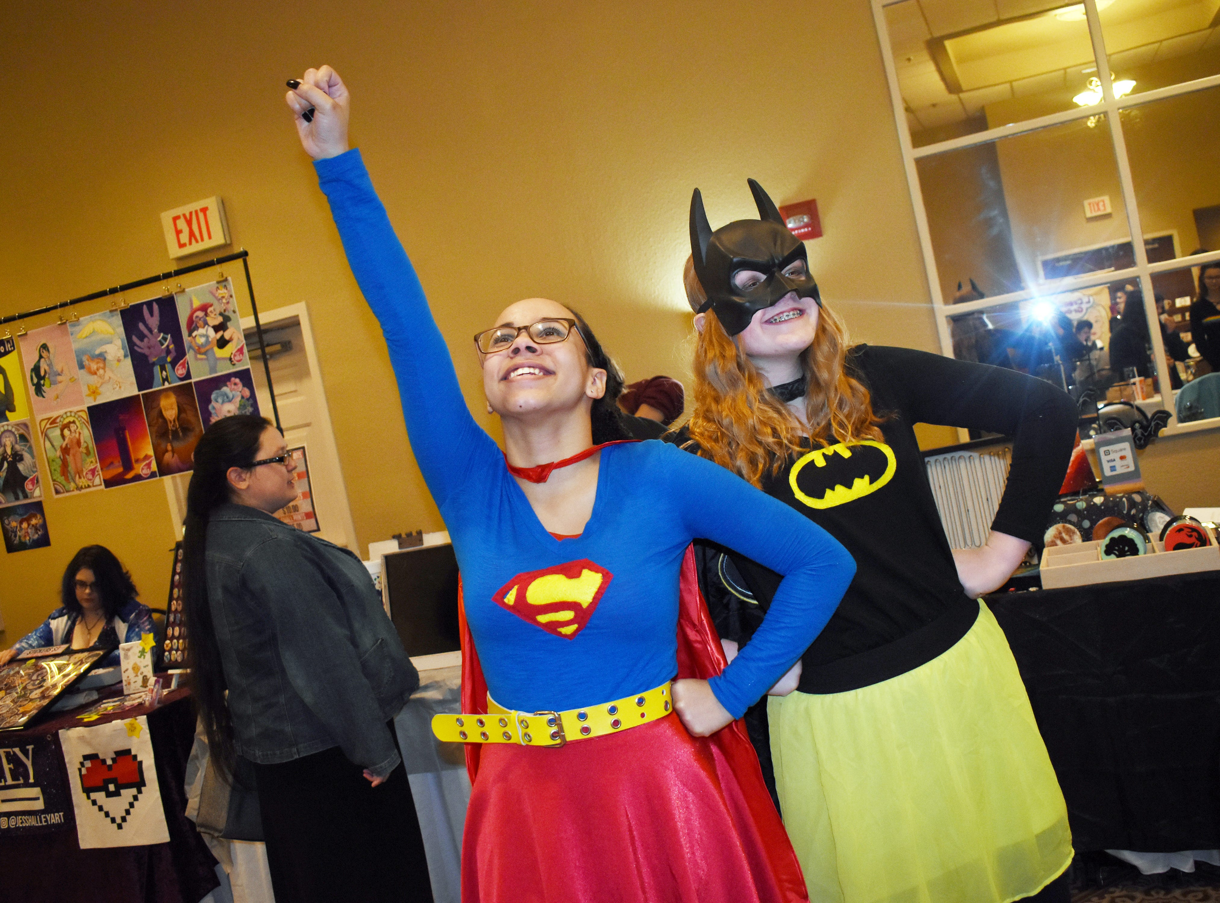Dressed as Supergirl and Batgirl, Rylee Garrison (left) and Abby Fisher strike poses at Creative Con 2019 held Saturday, Feb. 9, 2019 at the Best Western Inn & Suites on North MacArthur Drive. Creative Con is sponsored by the Rapides Parish Library and caters to all creative interests such as books, cosplay, gaming, art, steampunk, 3D printing and more. Among the panel discussions were a talk about acting and the acting business by Alexandria actor and stylist Dan Forest, and  discussions about magic by magician David Lebeouf, Doctor Who by Jack Sawtelle and writing by Christee Atwood. Other events included a costume contest, trivia games and play fighting by the Society for Creative Anarchronism.