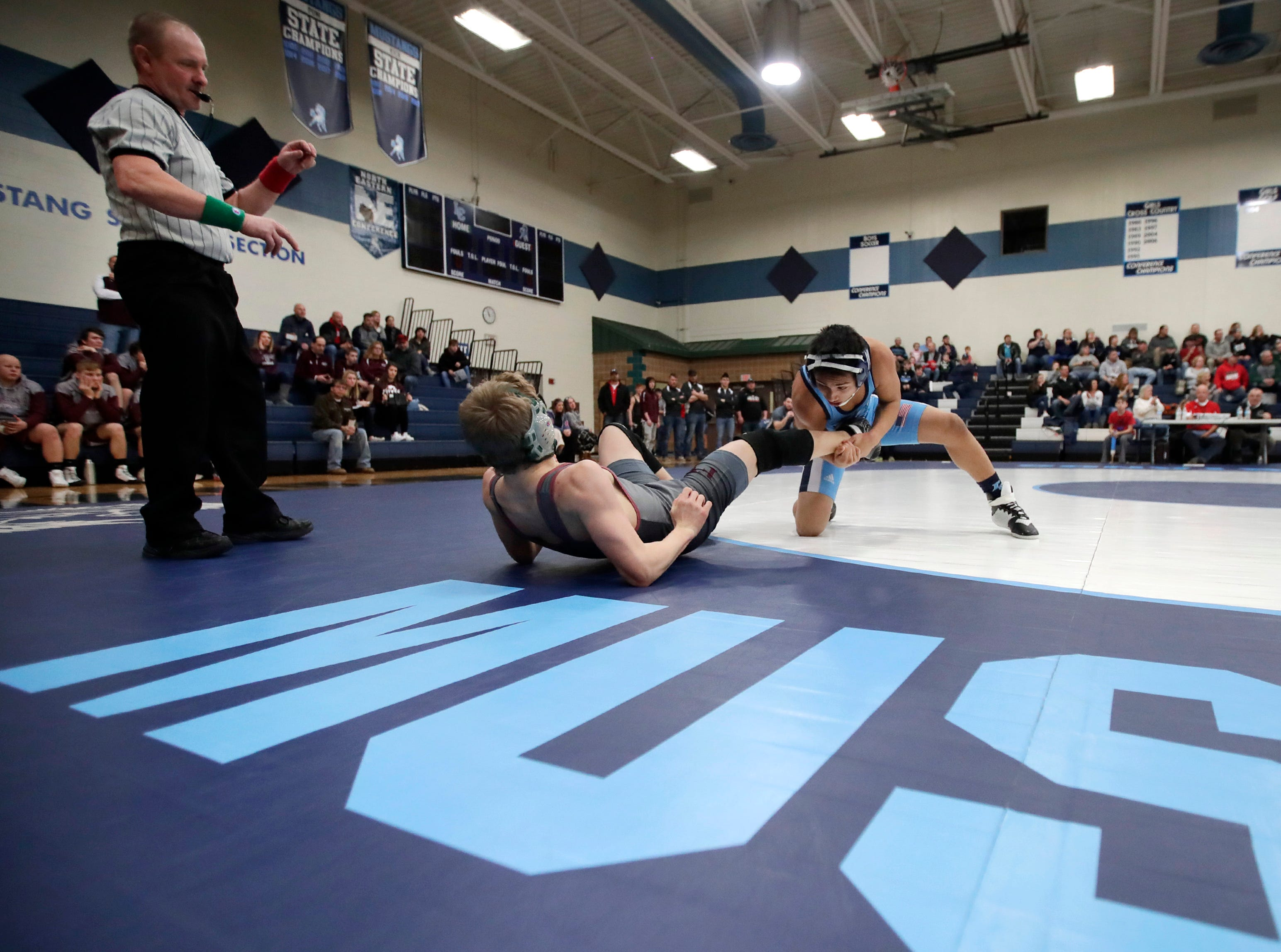Little Chute's Bryan Rodriguez takes down Fox Valley Lutheran's Isaac Haring during their D2 wrestling regional Saturday Feb. 9, 2019, in Little Chute, Wis.