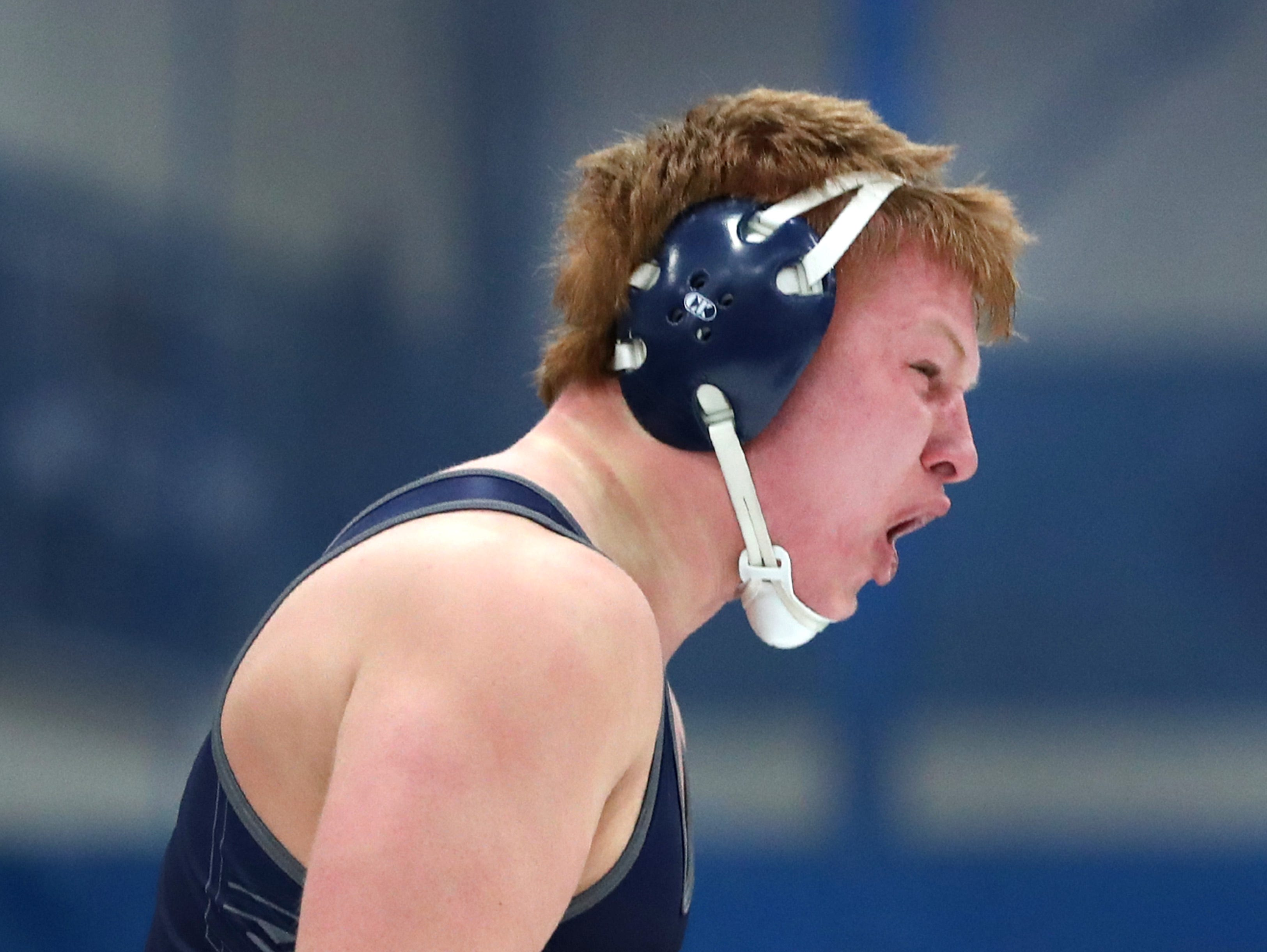 Xavier's Mac Strand celebrates his win over Omro's Kyle Dietzen during the 220-pound championship match in their D2 wrestling regional Saturday Feb. 9, 2019, in Little Chute, Wis.