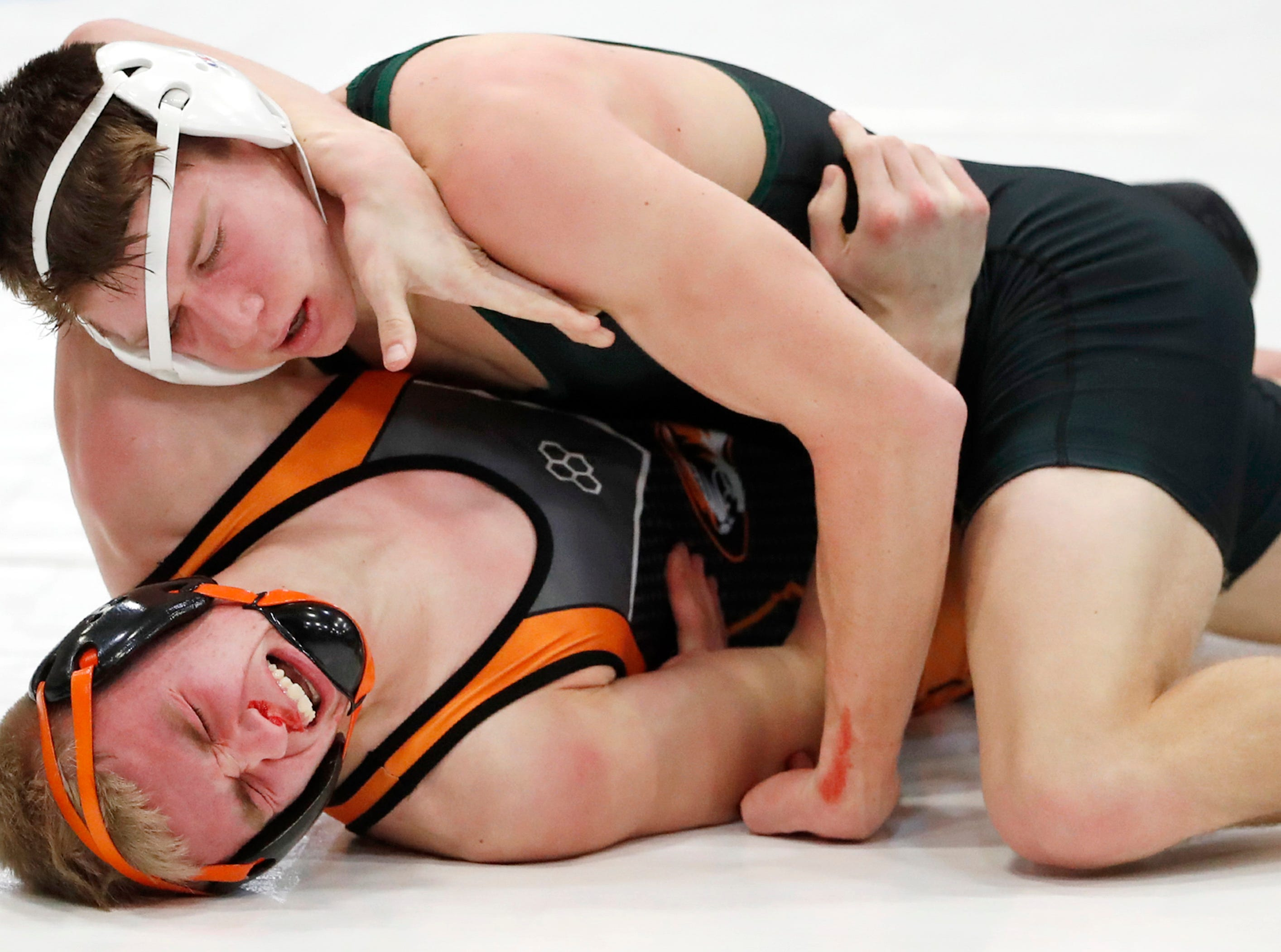 Berlin's Brady Wagner wrestles Ripon's Brady Kissinger at 160-pounds Saturday Feb. 9, 2019, in Little Chute, Wis.