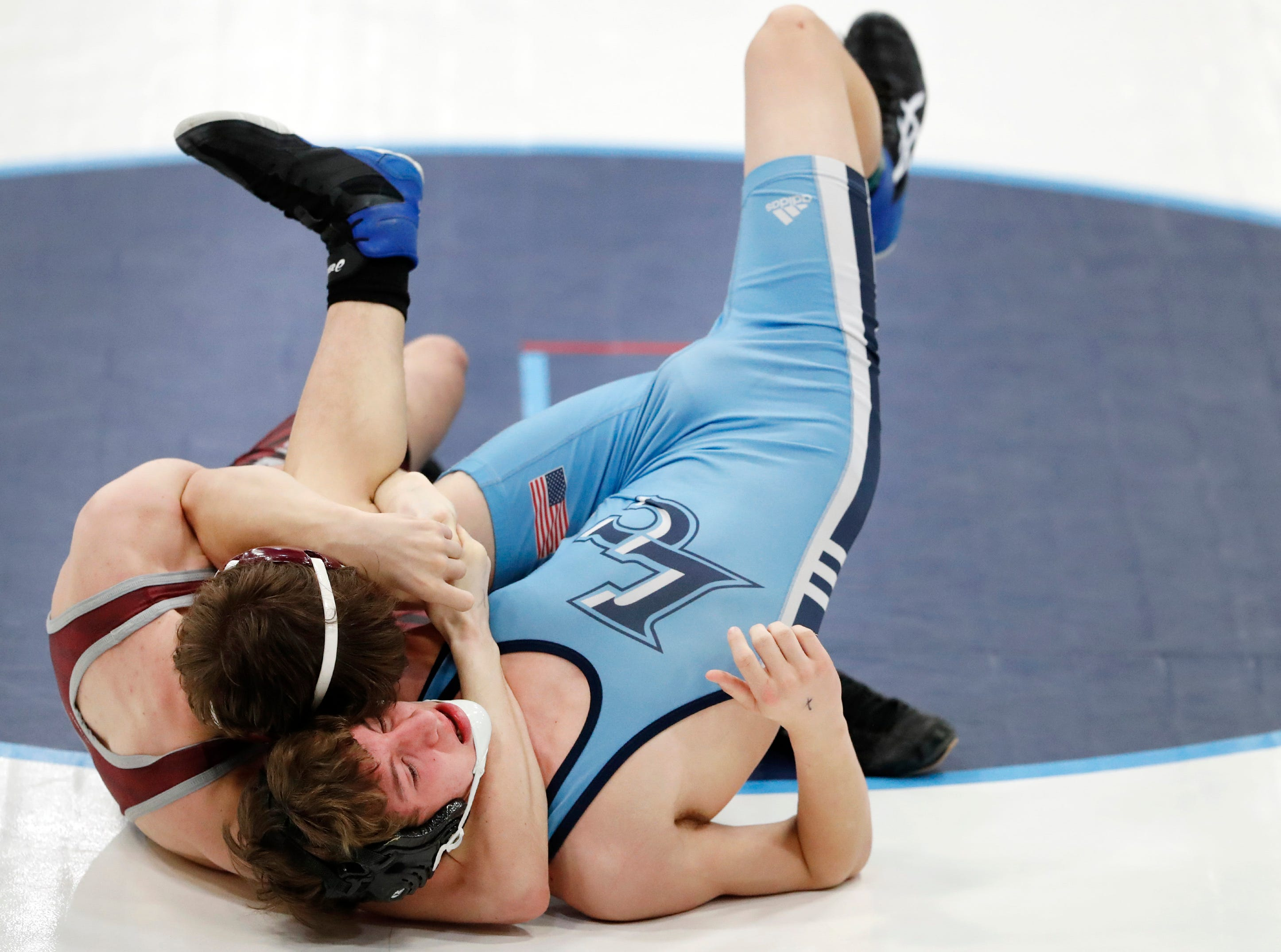 Winneconne's Nick Braun pins Little Chute's Devin Stanelle in the first round of their Division 2 wrestling regional Saturday Feb. 9, 2019, in Little Chute, Wis.